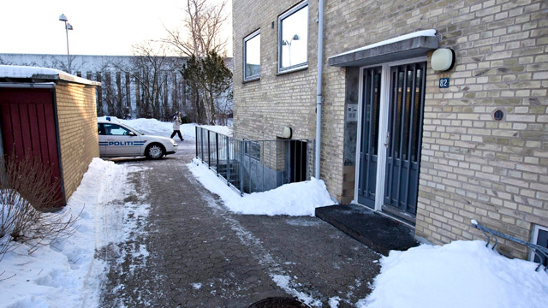 "Dec. 29: Police patrol in front of apartments in Herlev, west of Copenhagen, after Denmark's intelligence service arrested four people suspected of planning an ""imminent"" terror attack against a newspaper that printed the controversial Prophet Muhammad cartoons. The Danish Security and Intelligence Service, known as PET, said three of the four men were residents of Sweden and had entered the country during the night of Tuesday to Wednesday. Jakob Scharf, the head of PET, said that ""an imminent terror attack has been foiled."" He described some the suspects as ""militant Islamists."" (AP)"