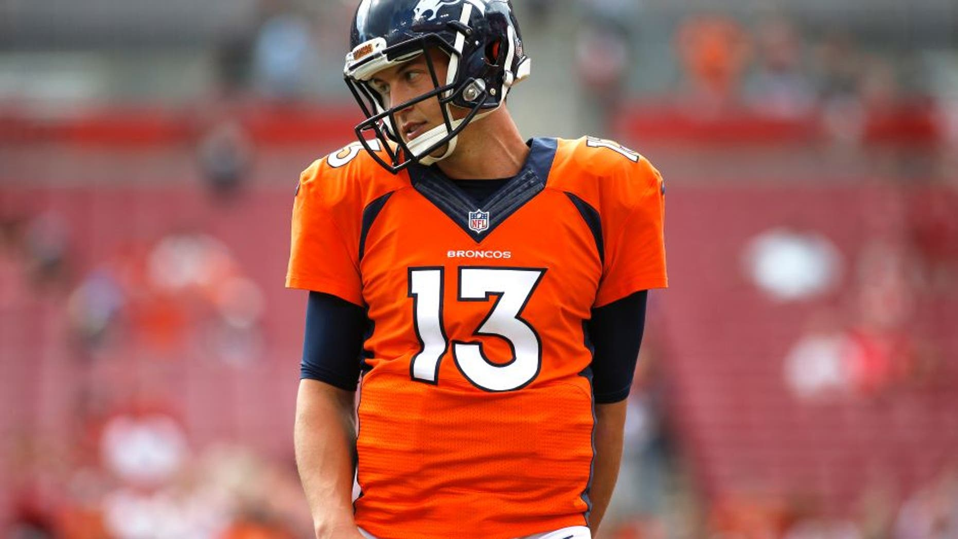 TAMPA, FL - OCTOBER 2: Quarterback Trevor Siemian #13 of the Denver Broncos warms up before the start of an NFL game against the Tampa Bay Buccaneers on October 2, 2016 at Raymond James Stadium in Tampa, Florida. (Photo by Brian Blanco/Getty Images)