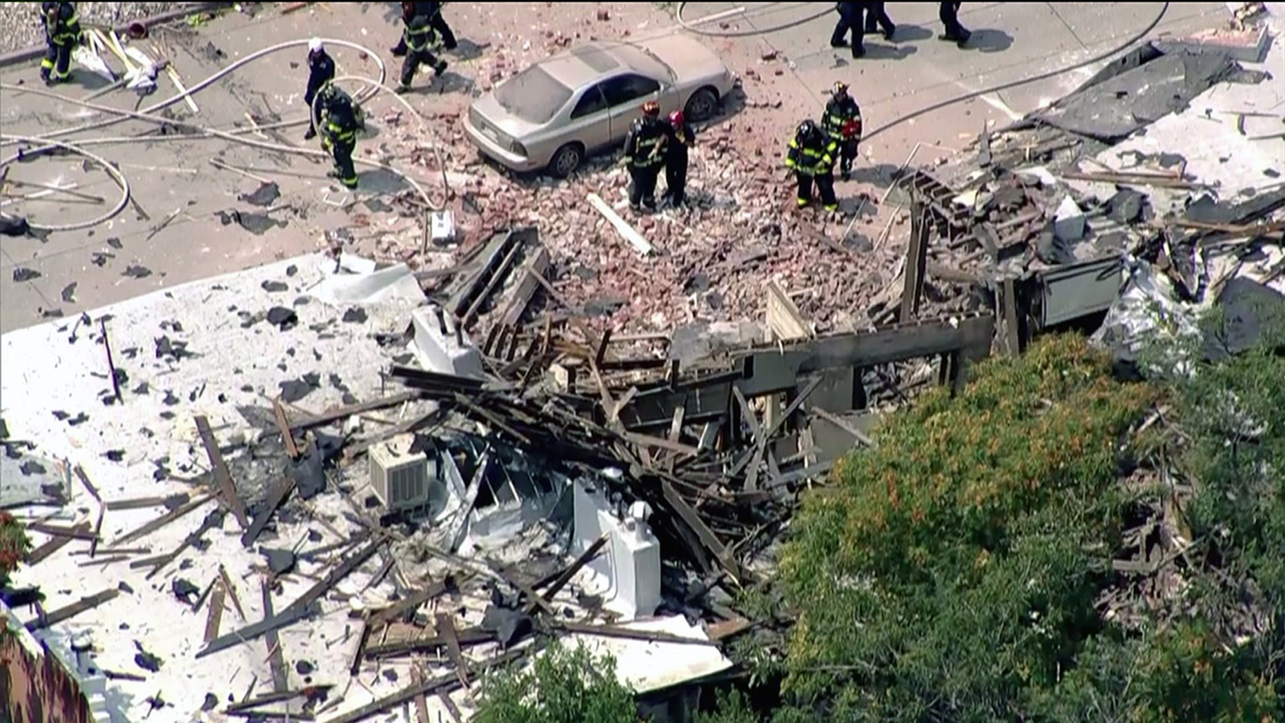 Firefighters respond to an apartment explosion in Denver, Colo. Tuesday.