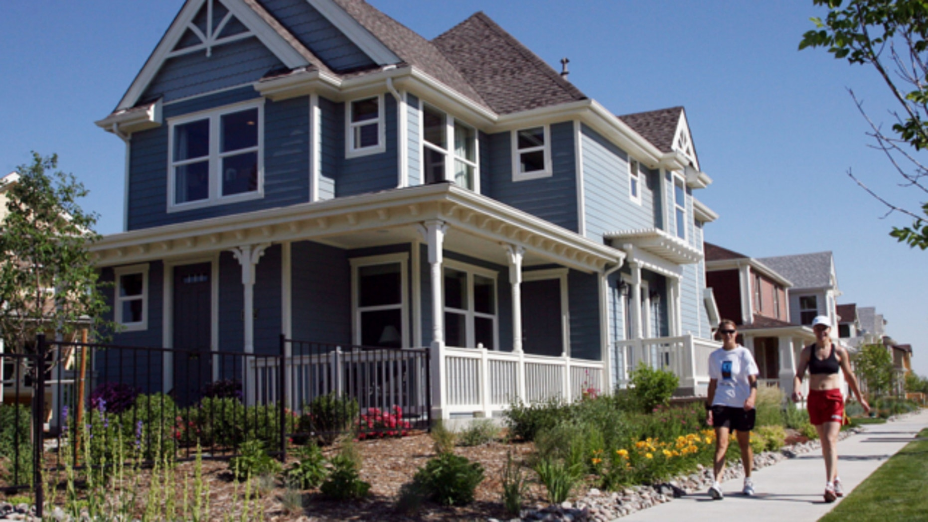 FILE: June 14, 2006: A model home by KB Homes in the Stapleton Coach House development is shown on the site of the defunct Stapleton International Airport in Denver, Colo.