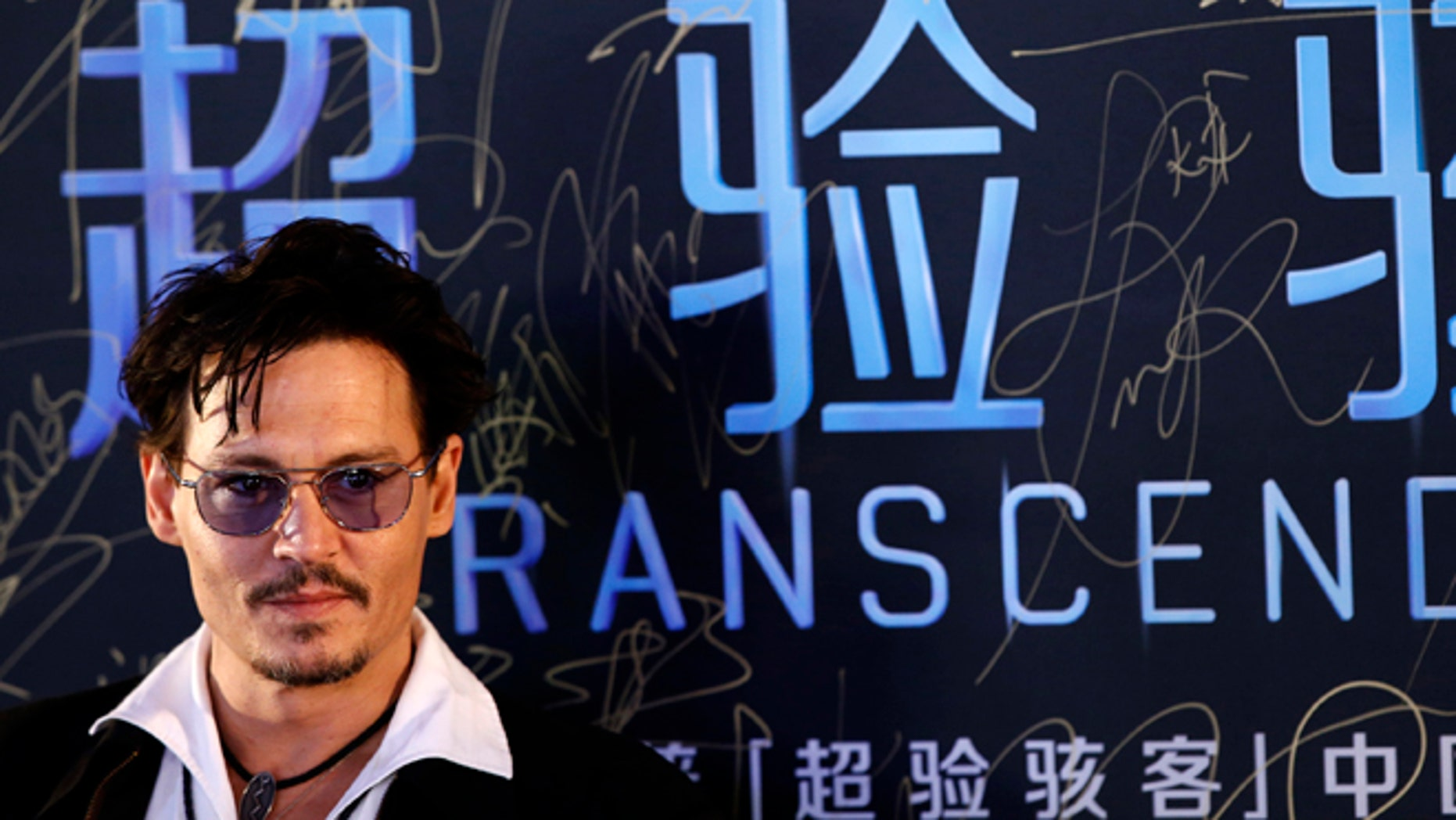 """Actor Johnny Depp attends a red carpet event to promote his new movie """"Transcendence"""", on his first visit to China in Beijing March 31, 2014.REUTERS/Kim Kyung-Hoon (CHINA - Tags: ENTERTAINMENT) - RTR3JBV1"""