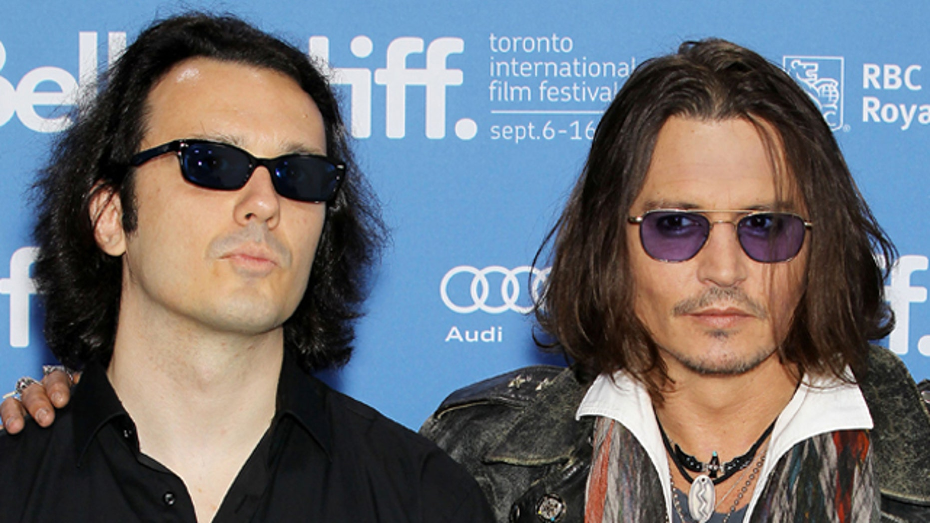 """Sept. 8, 2012: Damien Echols, one of the West Memphis Three, and actor Johnny Depp appear at a press conference for """"West of Memphis"""" at the 2012 Toronto International Film Festival. The pair, Echols told FoxNews.com, are """"like brothers"""" and have four matching tattoos. (AP/STARPIX)"""