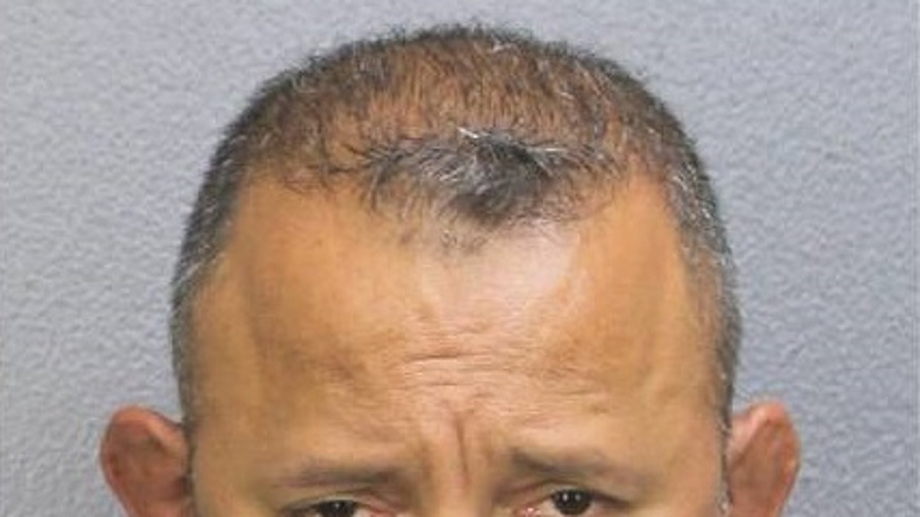 Deputy Henry Guzman was arrested after he allegedly stole some $200 from a Florida Walmart.