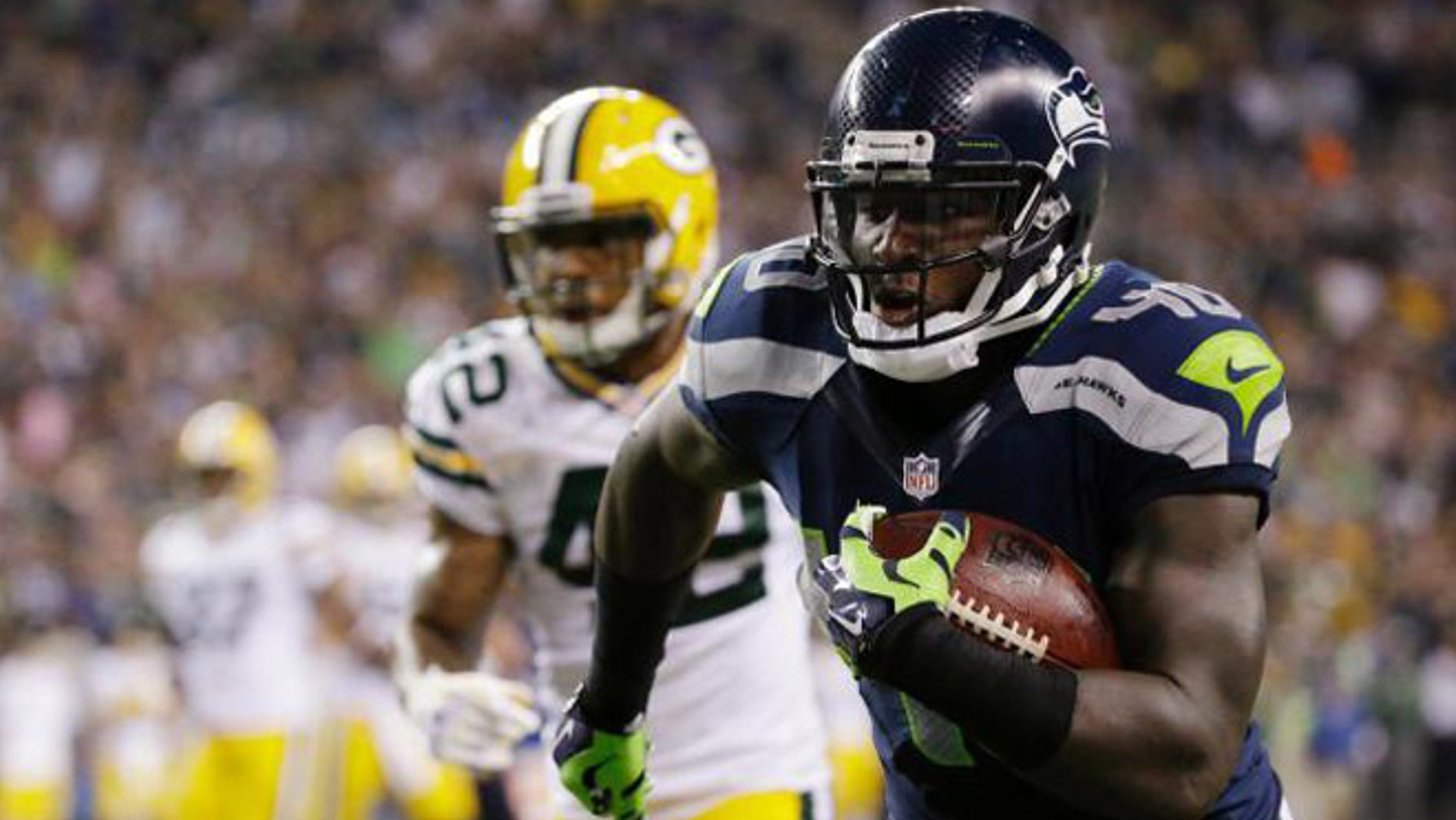 In this Sept. 4, 2014, photo, Seattle Seahawks fullback Derrick Coleman, right, runs for a touchdown in the second half of an NFL football game against the Green Bay Packers in Seattle.(AP Photo/Elaine Thompson)