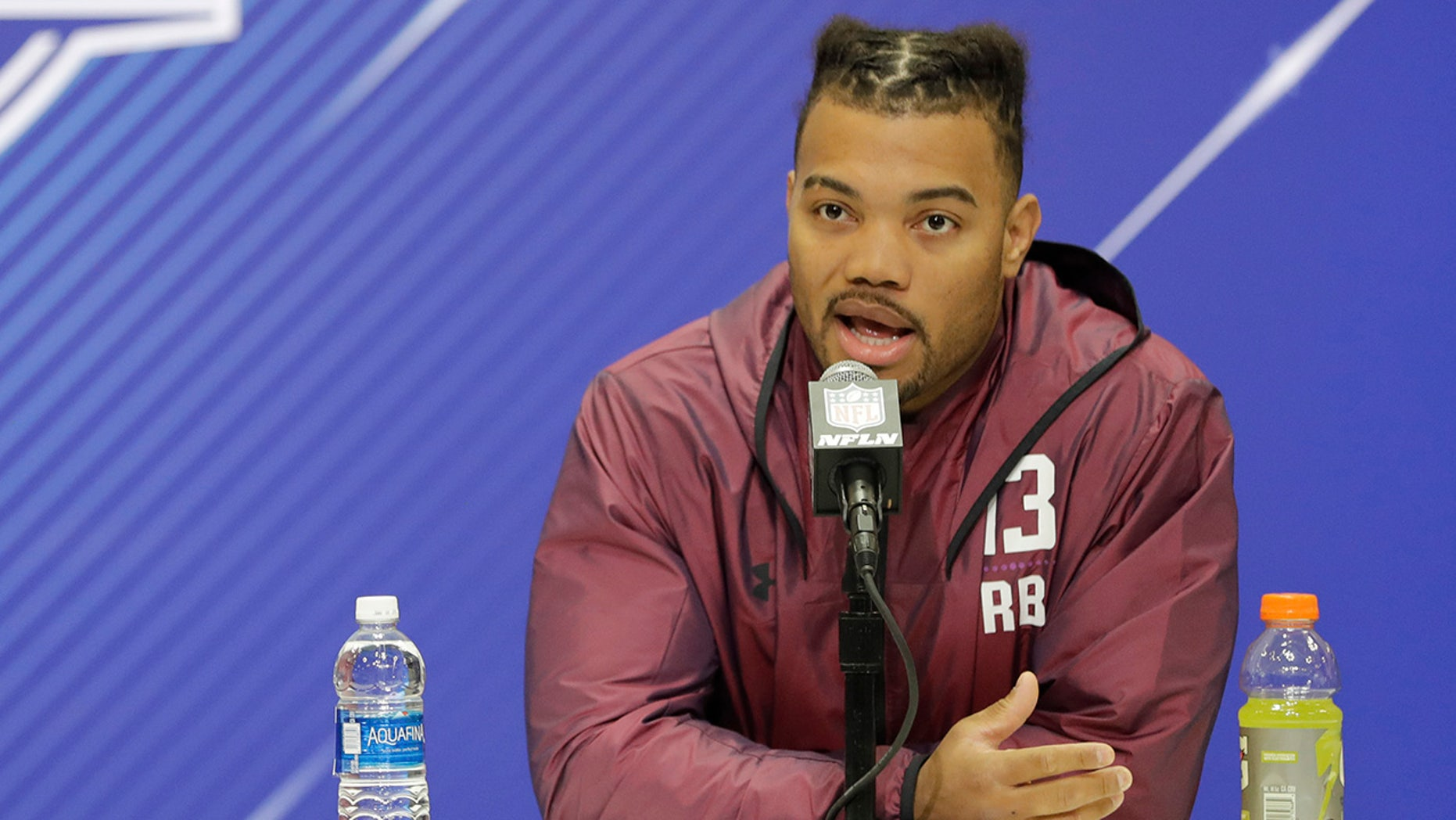 Louisiana State running back Derrius Guice speaks during a press conference at the NFL football scouting combine, Thursday, March 1, 2018, in Indianapolis.