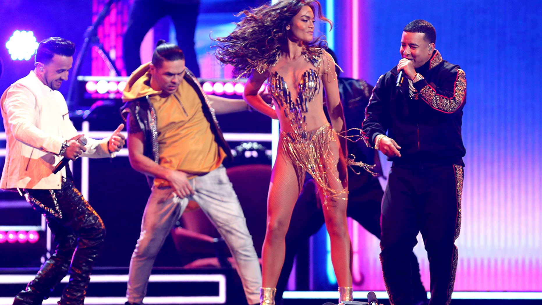 "Luis Fonsi, left, and Daddy Yankee, right, perform ""Despacito"" as Zuleyka Rivera dances at the 60th annual Grammy Awards at Madison Square Garden on Sunday, Jan. 28, 2018, in New York."