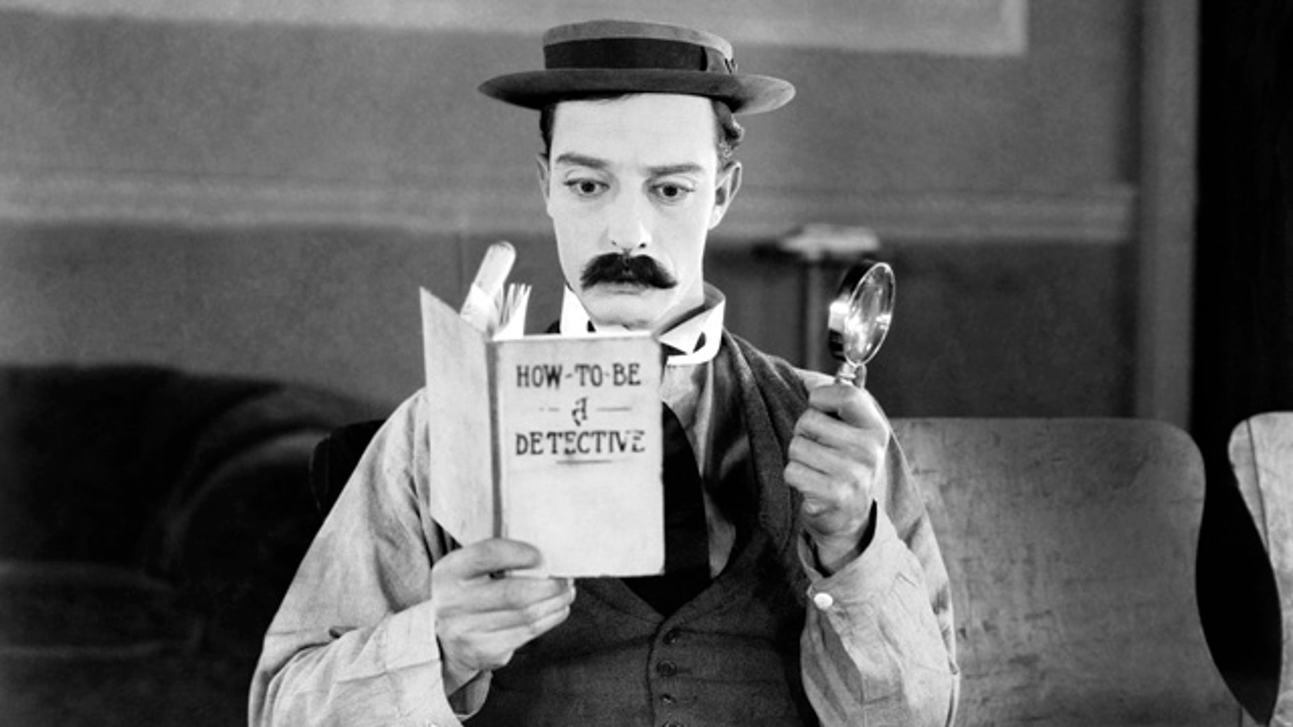 American comedian Buster Keaton hopes to become a great detective in the film 'Sherlock Junior.'