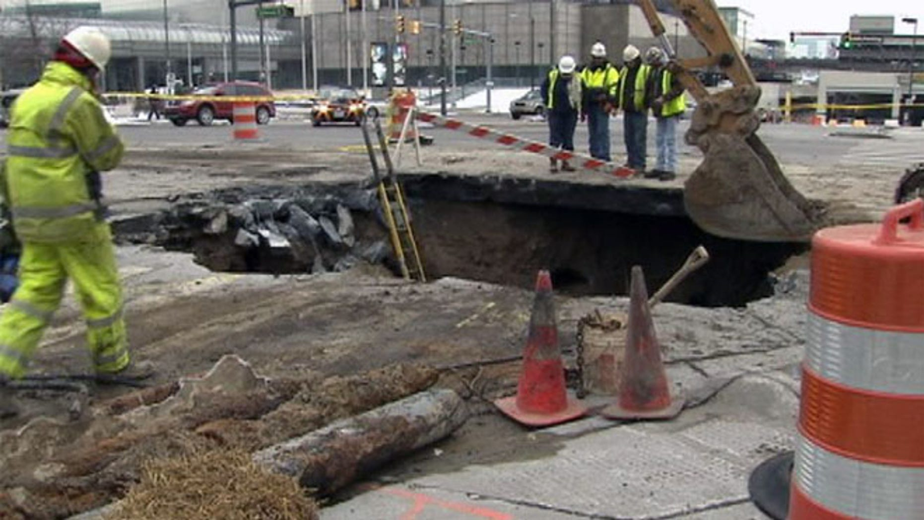 Crews are picture working on a sinkhole that has opened up in Detroit.