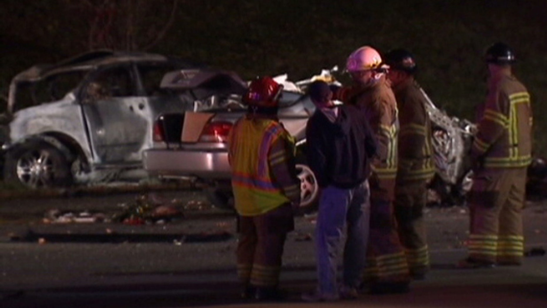 Oct. 23, 2011: First responders on the scene after a deadly car accident in Southfield, Mich.
