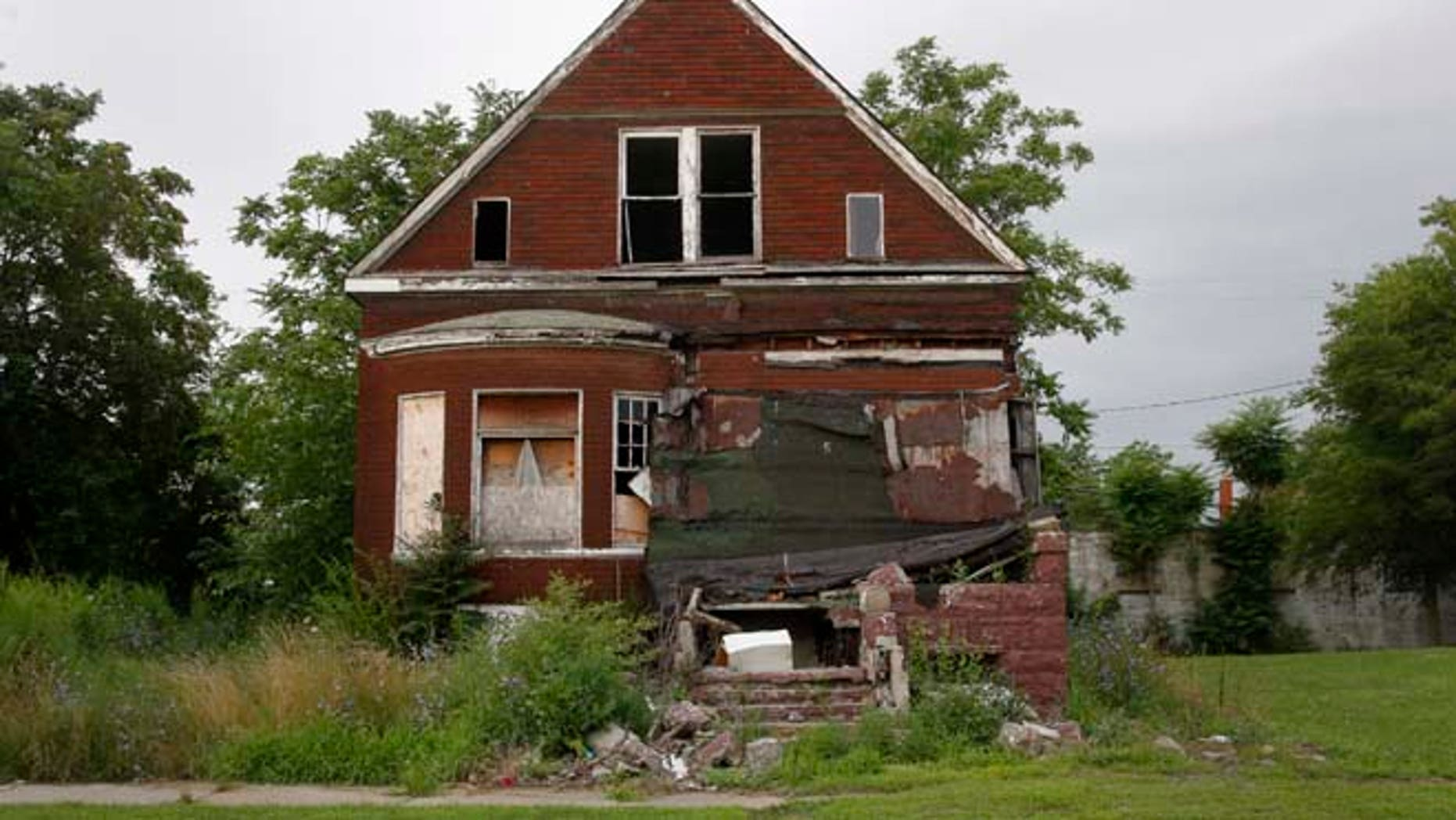 In this July 23, 2013 file photo, a vacant blighted home is seen on a street that was once lined with houses in Detroit, Michigan.