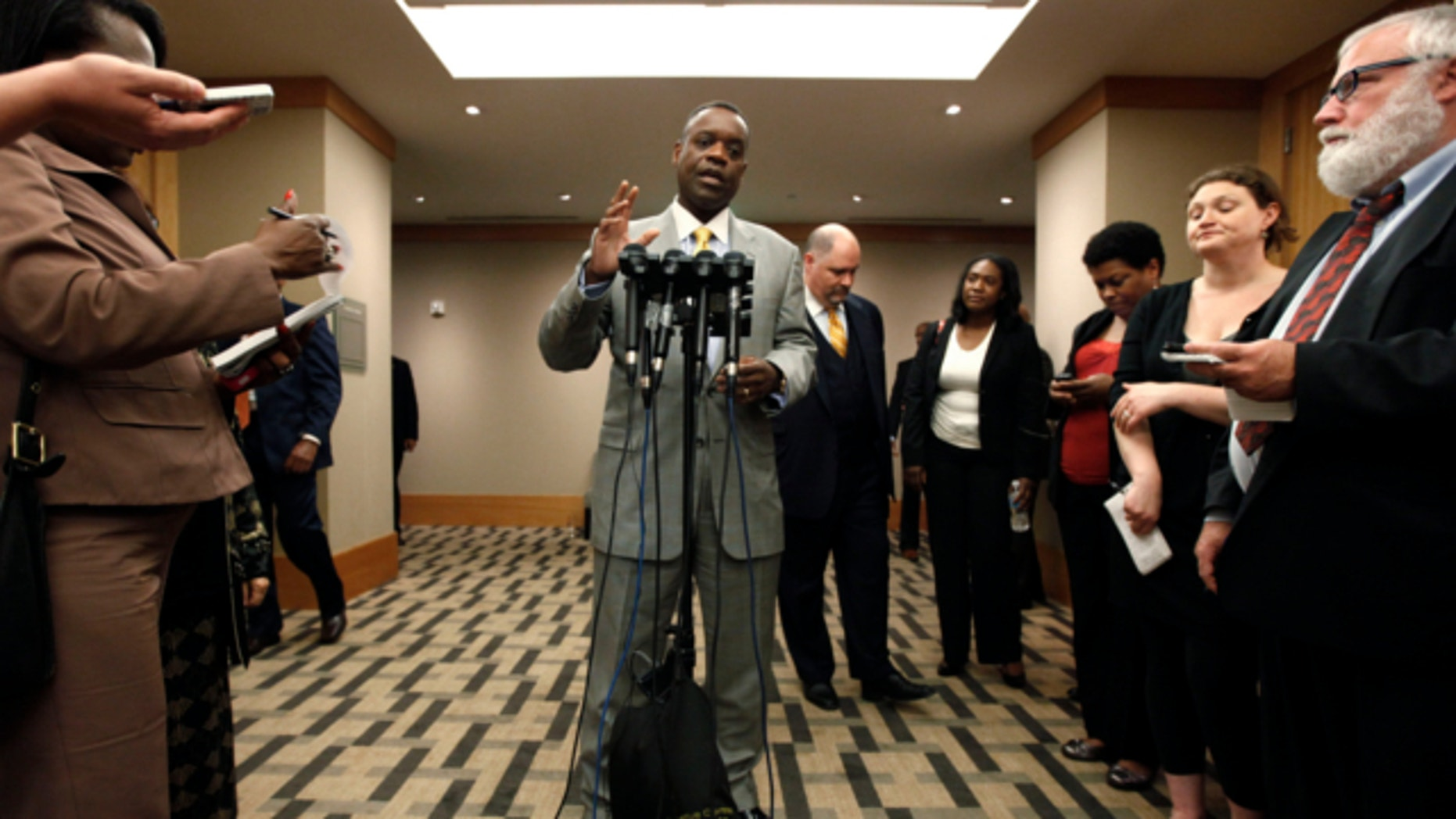 June 14, 2013: Detroit emergency manager Kevyn Orr speaks with reporters after a meeting with creditors in Romulus, Mich.
