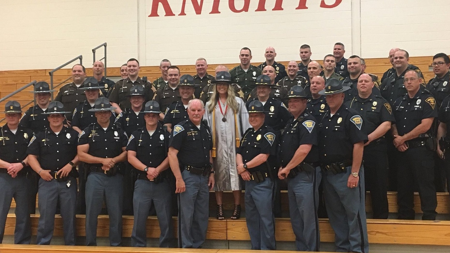 Lauren Rich had 39 Indiana police officers at her high school graduation on Saturday.