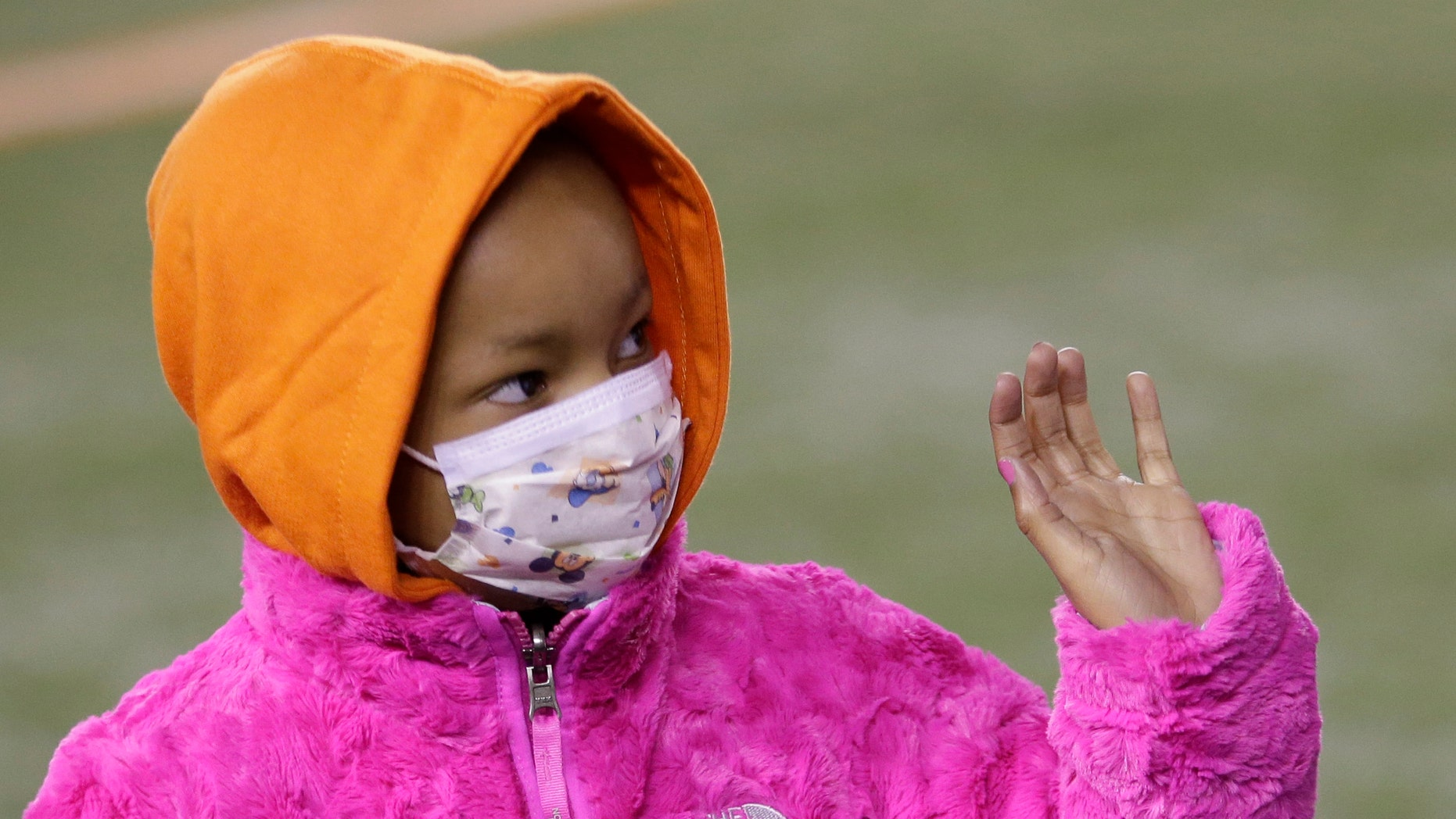 Nov. 6, 2014: Leah Still waves during a ceremony in the first half of an NFL football game between the Cincinnati Bengals and the Cleveland Browns