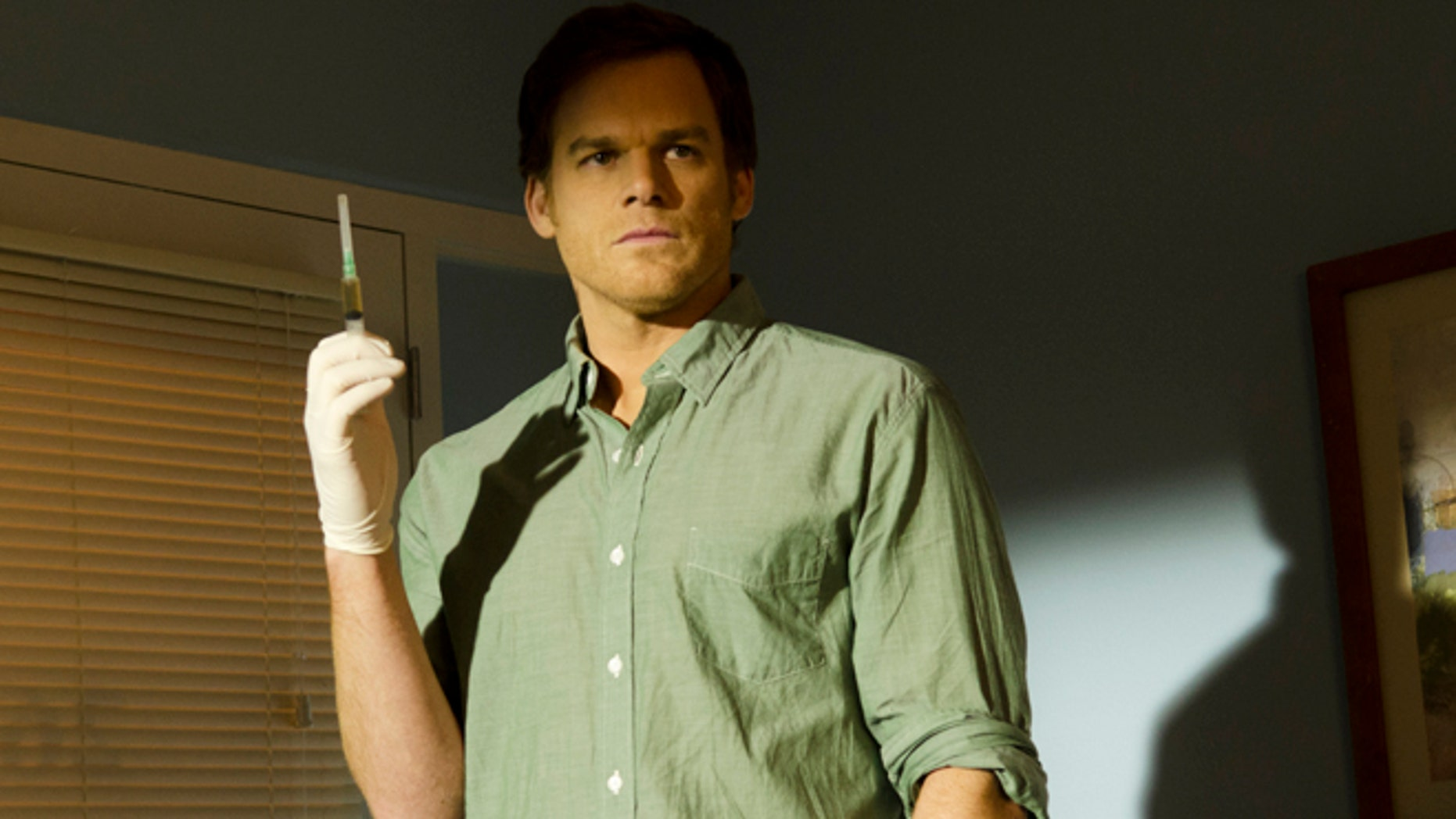 """This undated publicity image released by Showtime shows Michael C. Hall as Dexter Morgan in a scene from the final season of """"Dexter,"""" airing  on Showtime."""