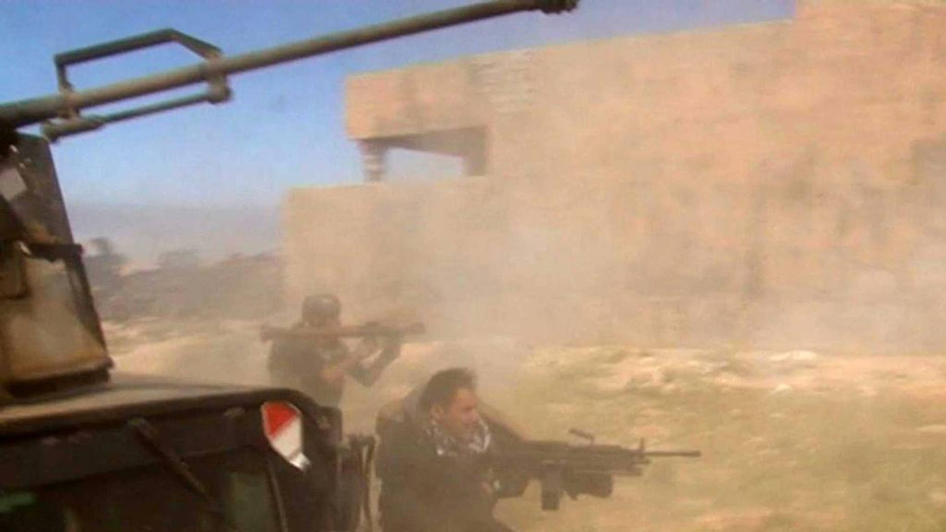March 11, 2015: In this still image taken from video, soldiers fire towards a target in Tikrit, Iraq on Wednesday. (AP)