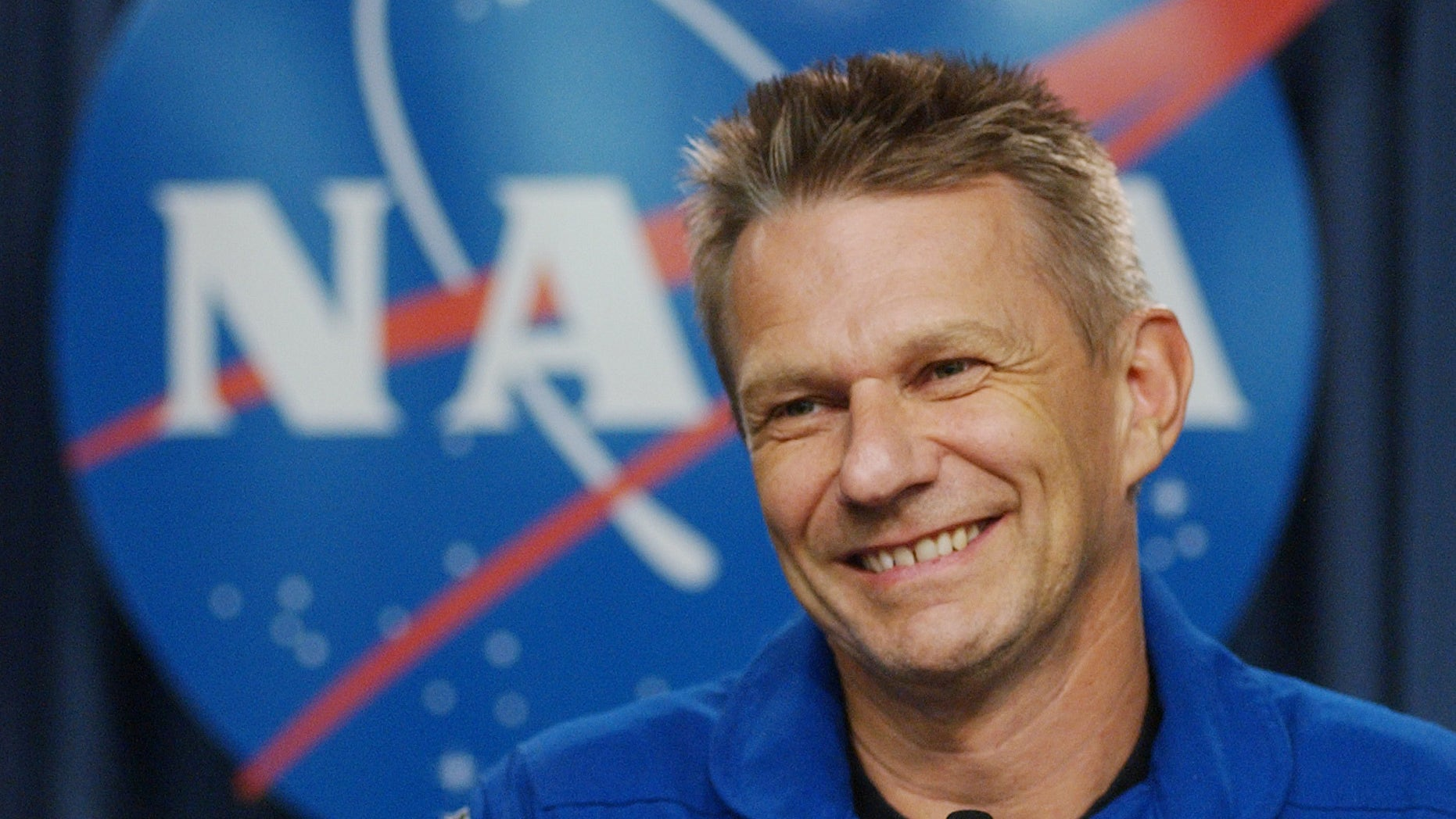 FILE - In this July 17, 2006 photo, British born U.S. Astronaut Piers Sellers talks with reporters following the safe return the space shuttle Discovery at the Kennedy Space Center in Cape Canaveral, Fla. Sellers, a climate scientist and former astronaut died Friday, Dec. 23, 2016. He was 61. (AP Photo/Pete Cosgrove, File)