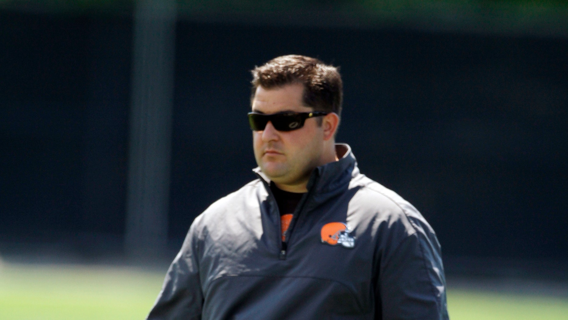 In this June 7, 2012 photo, Cleveland Browns director of player personnel Jon Sandusky watches an off-season practice at the NFL football team's headquarters in Berea, Ohio. Jon Sandusky, the son of former Penn State assistant coach Jerry Sandusky, was arrested early Tuesday morning, Oct. 8, 2013, on suspicion of drunken driving. Fargo, N.D. police Lt. Joel Vettel told The Forum of Fargo-Moorhead that an officer spotted Jon Sandusky, 36, making an illegal turn. The officer pulled Sandusky over and decided he was driving under the influence after administering field sobriety tests. (AP Photo/Mark Duncan)