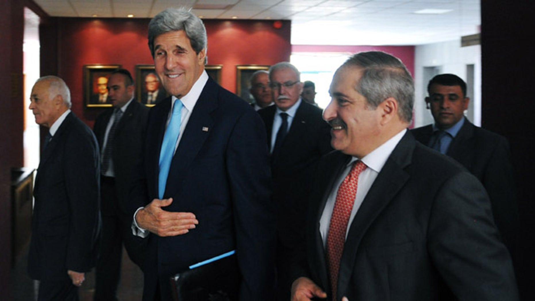 July 17, 2013: U.S. Secretary of State John Kerry, center, Jordan's Foreign Minister Nasser Judeh, right, and Egypt's Foreign Minister Mohammed Kamel Amr, left, arrive for a meeting with the Arab League Peace Initiative at the Ministry of Foreign Affairs in Amman, Jordan.