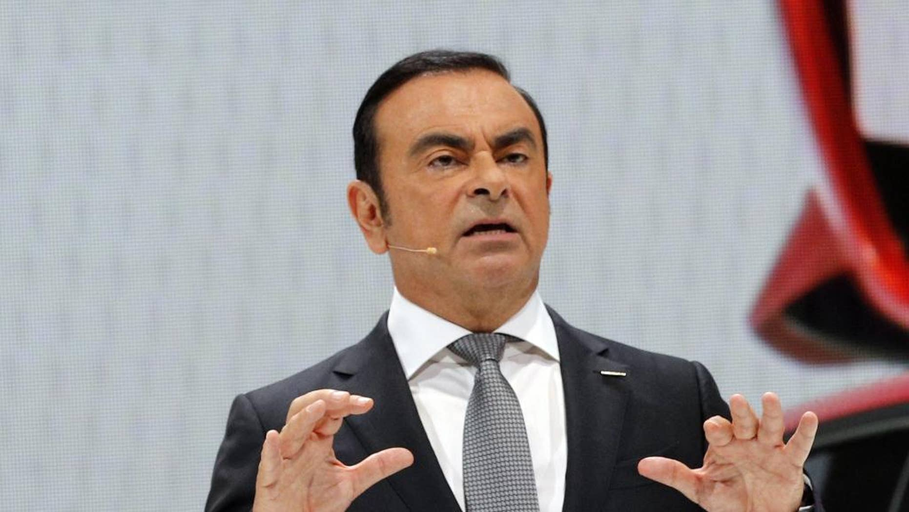 Nissan Motor Co. President and CEO Carlos Ghosn addresses the media during the presentation of the Nissan Micra as part of the first press day at the Paris Auto Show in Paris, France, Thursday, Sept. 29, 2016. The Paris Auto Show will open its gates to the public from Oct. 1st to 16th. (AP Photo/Christophe Ena)
