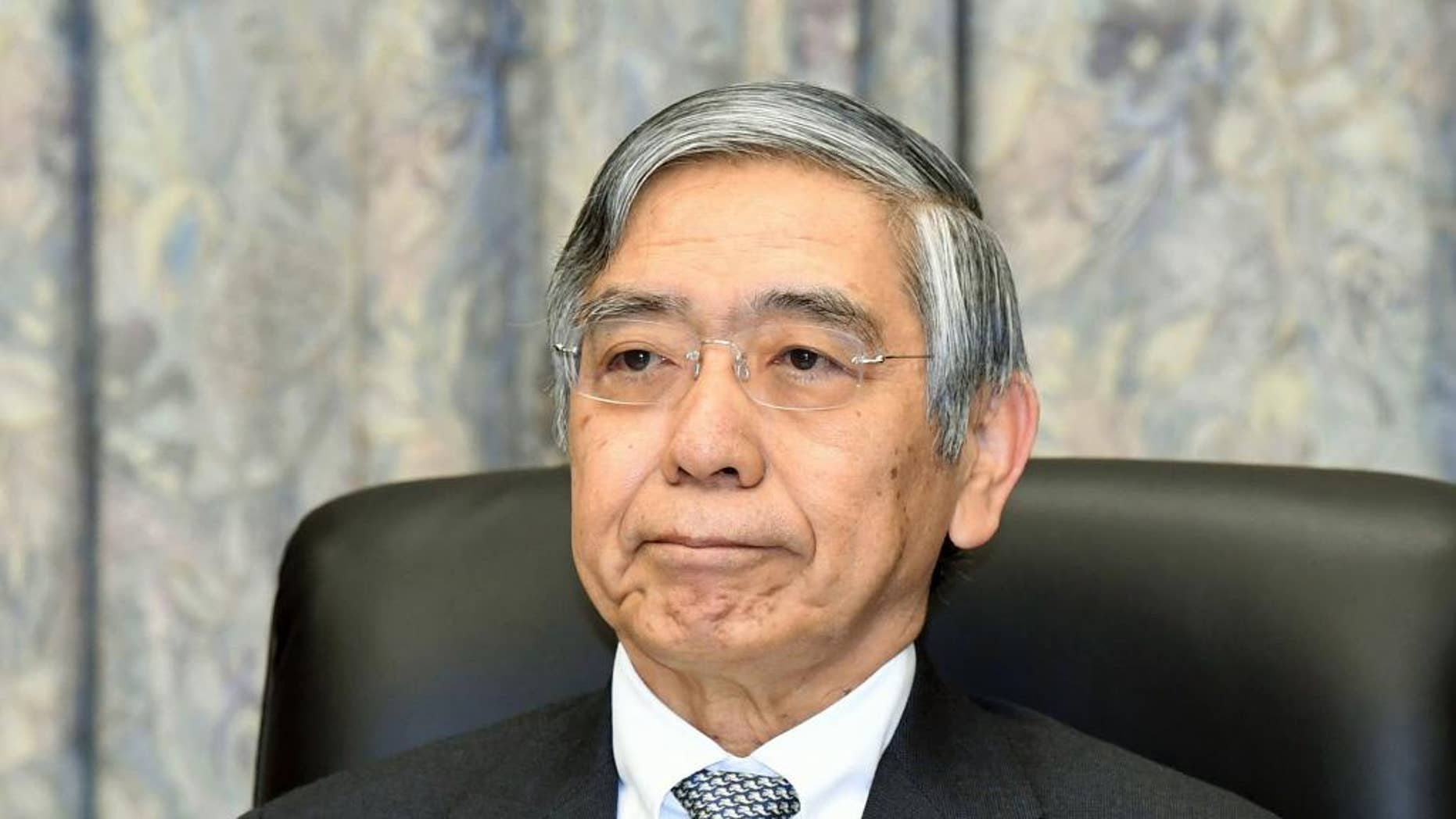Bank of Japan Gov. Haruhiko Kuroda attends a meeting at the central bank headquarters in Tokyo Tuesday, Dec. 20, 2016. Japan's central bank wrapped up its final meeting of the year Tuesday on an upbeat note, citing signs of improvement in exports, investment and industrial production, while keeping its ultra-lax monetary policy unchanged. (Kyodo News via AP)