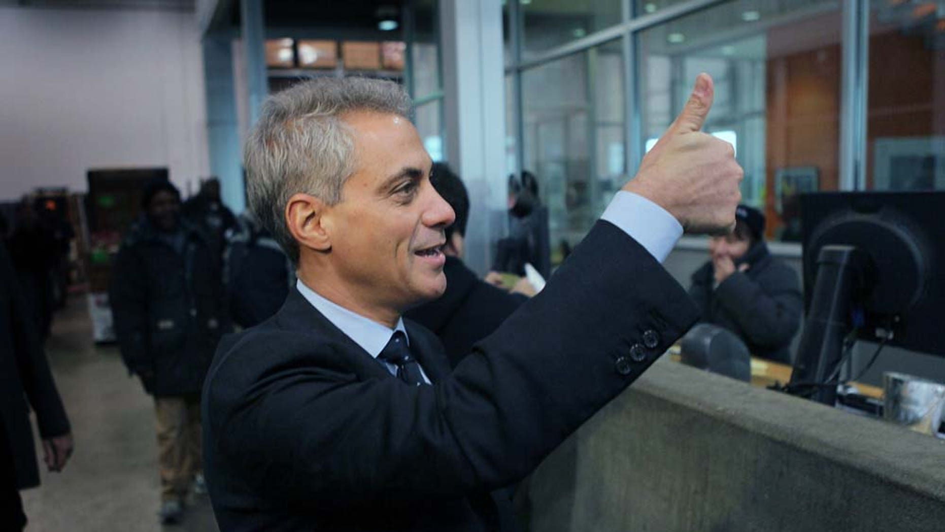 CHICAGO, IL - JANUARY 25:  Mayoral candidate and former White House Chief of Staff Rahm Emanuel gives teh thumbs up at a produce distribution warehouse where he received the endorsement of Teamsters Joint Council 25 on January 25, 2011 in Chicago, Illinois. According to reports, Emanuel has been placed back on the Chicago Mayoral ballot after the Illinois Supreme Court issued a stay on an Illinois Appellate Court decision that he didn't meet Chicago residency requirements to run for mayor.  (Photo by Scott Olson/Getty Images)