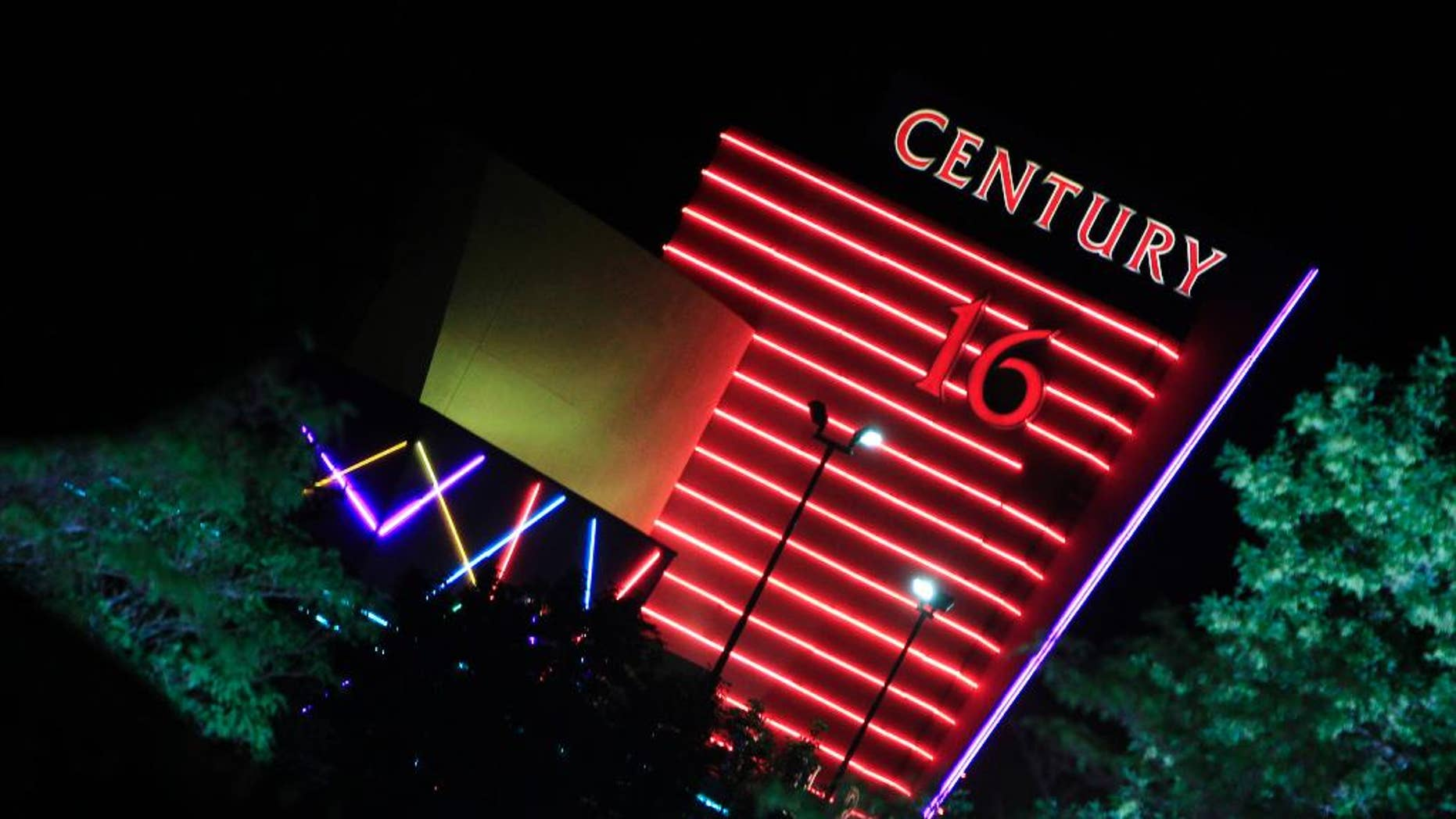 """FILE - In this Friday, July 20, 2012 file photo, the neon sign over the Century 16 theatre burns bright in the night east of the Aurora Mall in Aurora, Colo. The theatre was the scene of a bloody rampage in which 12 people died and 70 were injured during a bloody assault at the July 20, 2012 midnight premiere of """"The Dark Knight."""" On Monday, May 9, 28 victims' families will argue that Century Theatres should be held accountable for not doing more to prevent the slaughter in its property. (AP Photo/David Zalubowski, file)"""