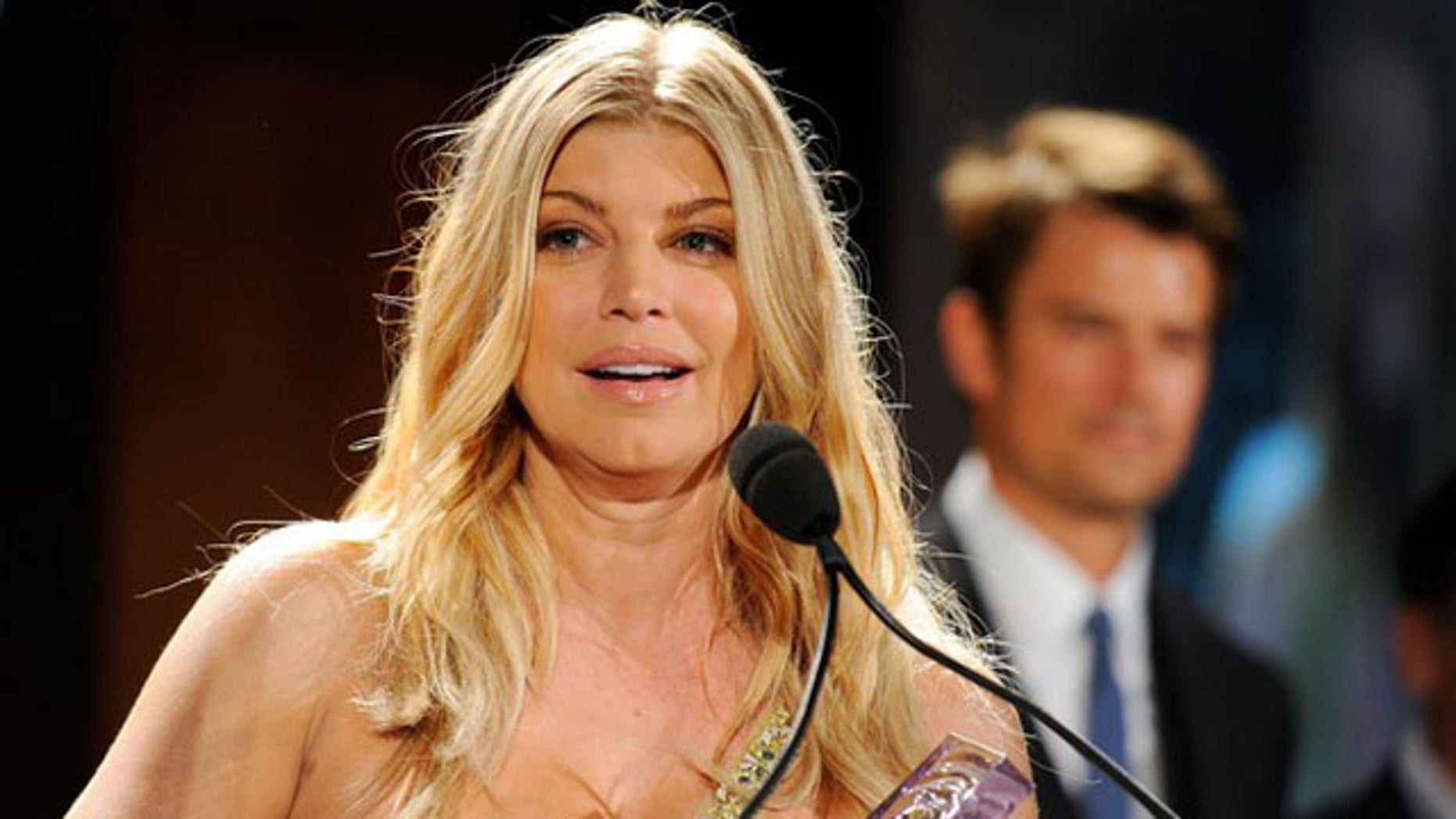 MAY 25:  Singer Fergie accepts the FiFi New Celebrity Fragrance of the Year Award.