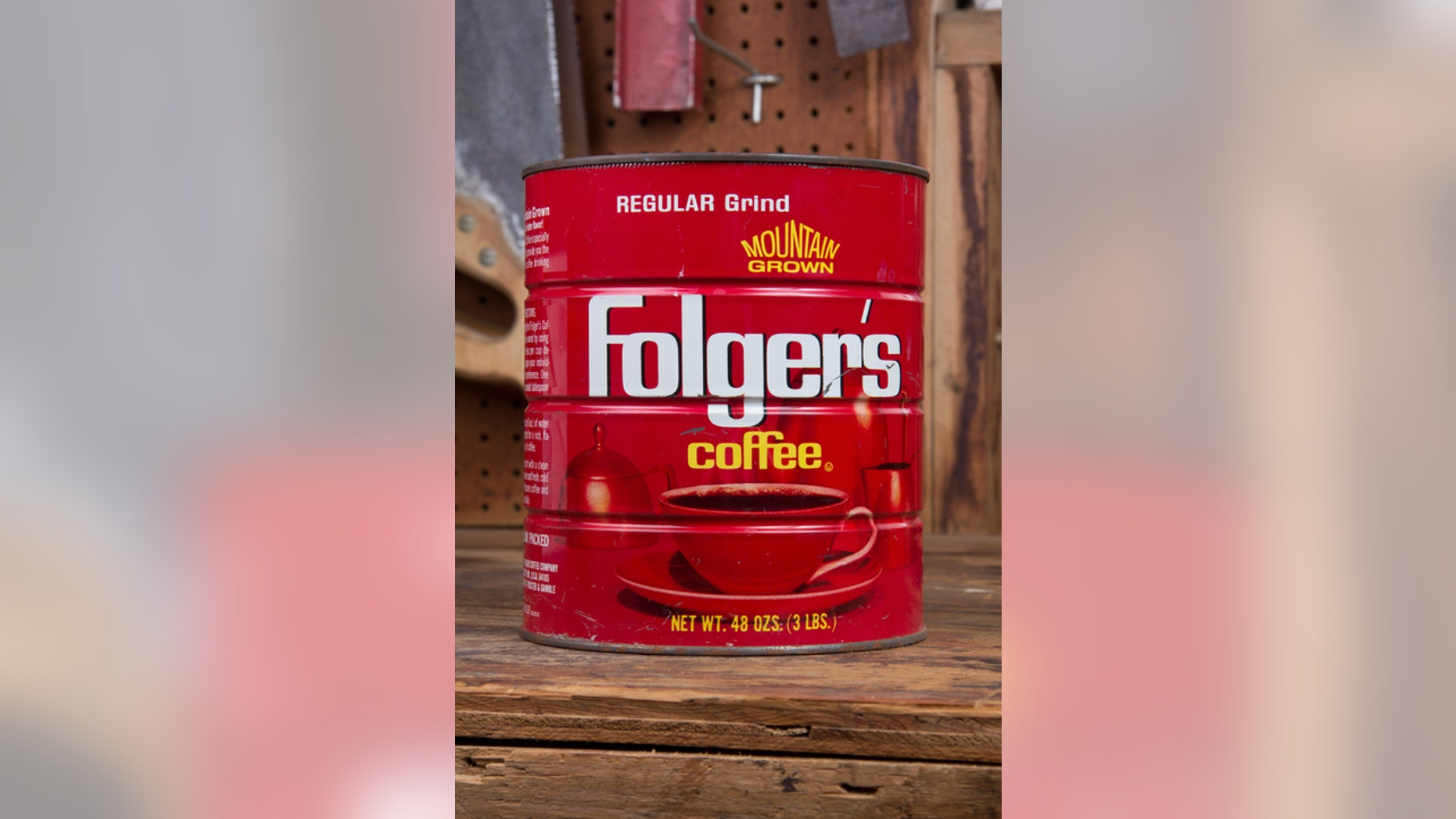 Joliet, IL- July 5, 2014: The coffee can remains a stand presence in the garage work space s a catch all for nails, bolts and miscellaneous items.
