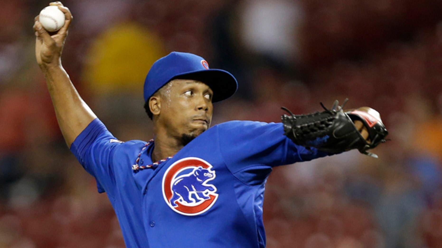 In this Aug. 26, 2014, file photo, Chicago Cubs relief pitcher Pedro Strop throws against the Cincinnati Reds during the eighth inning of a baseball game in Cincinnati. Strop was involved in a car accident in his native Dominican Republic but was not injured, officials said Friday, Nov. 28, 2014. The 29-year-old was driving a pickup truck when he crashed against a wall late Wednesday along a road southwest of the capital of Santo Domingo. (AP Photo/Al Behrman, File)