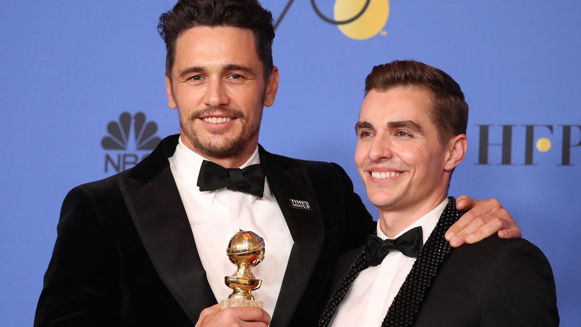 "From the left, James Franco poses with his brother Dave Franco after winning a Golden Globe for ""The Disaster Artist."""