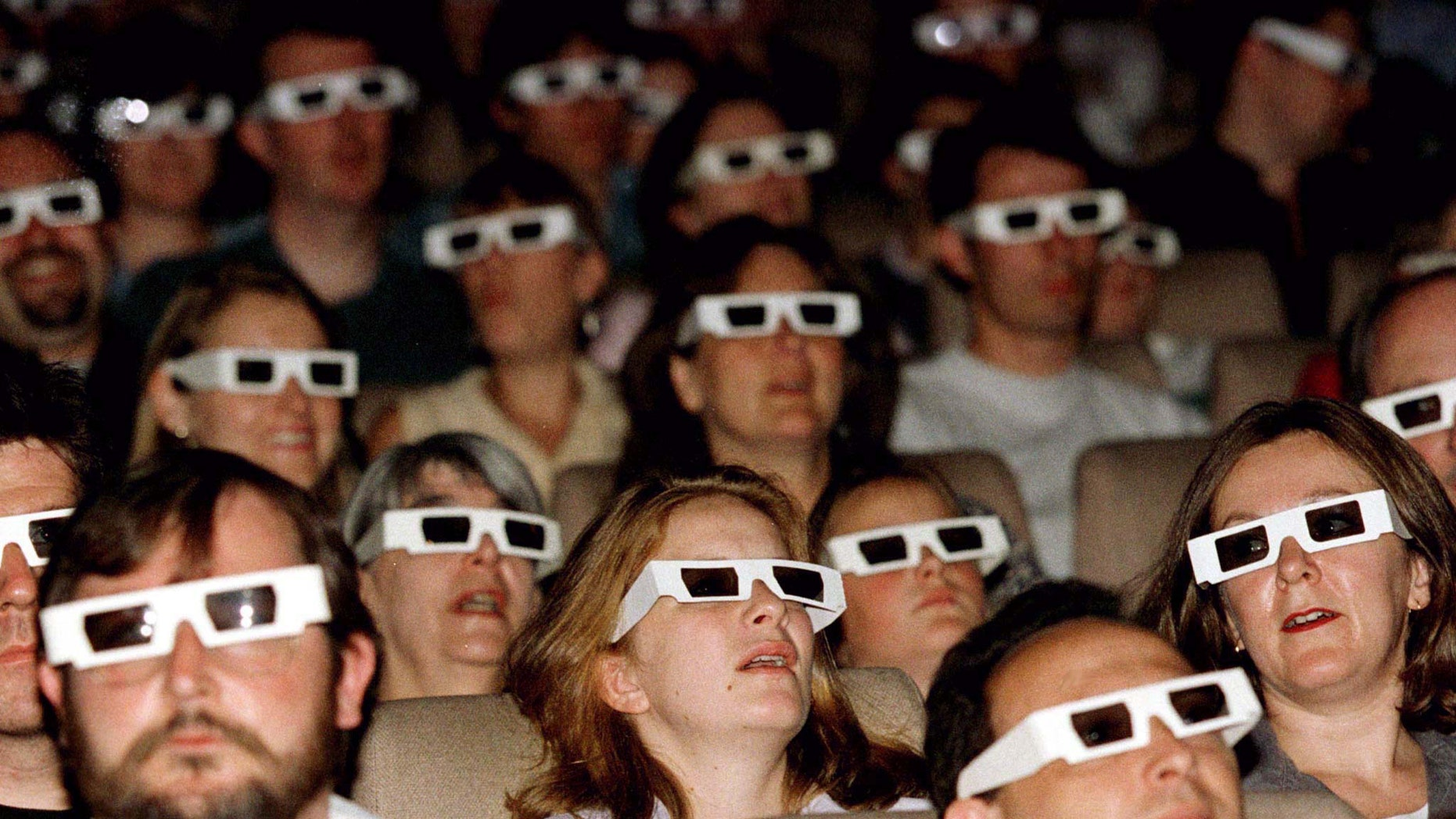 File photo - An audience watches a film through 3D spectacles at the launch screening of The National Film Theatre 3D film season, August 8, 1996. (Reuters)