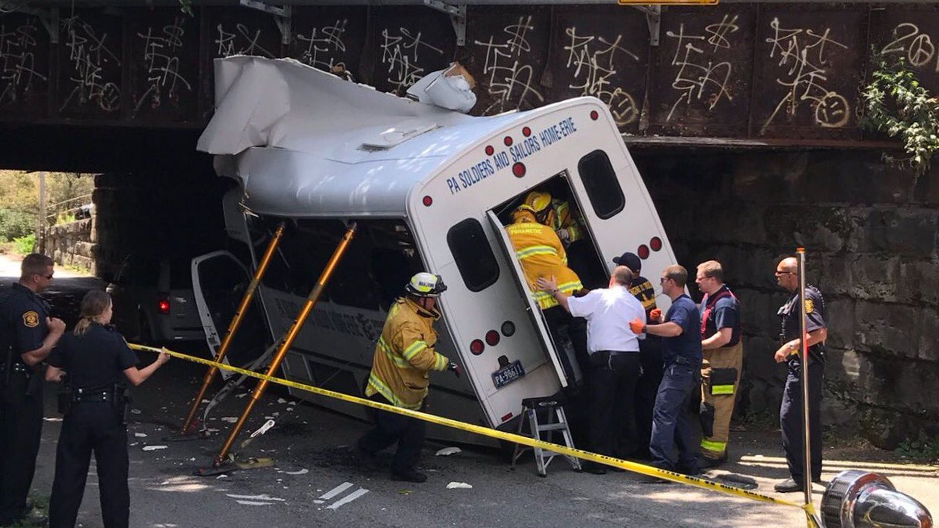 The bus carrying veterans crashed around 12 p.m. Thursday in Pittsburgh. (Pittsburgh police department)