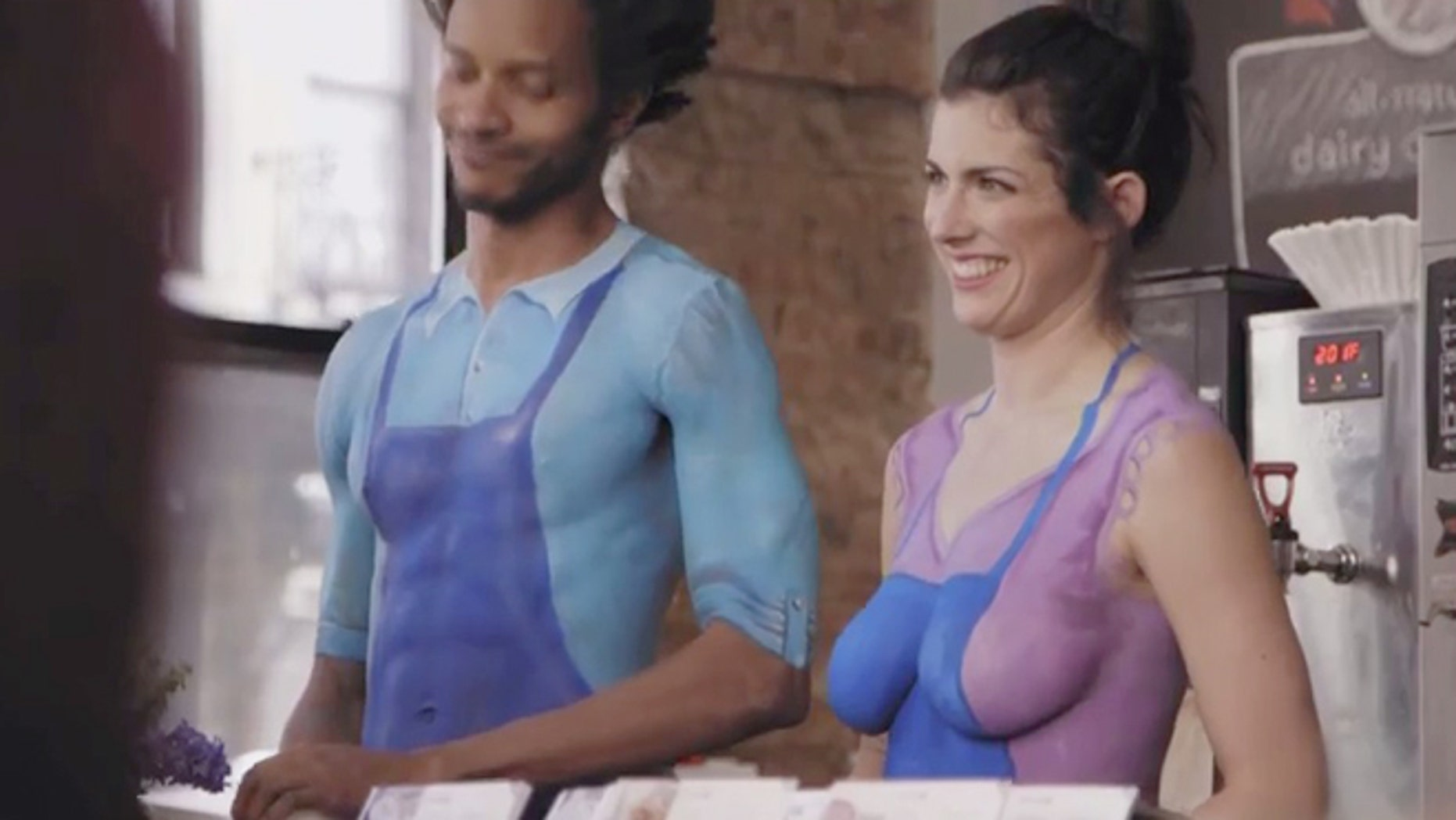 Naked baristas serve surprised patrons coffee in Nestle's new commercial.