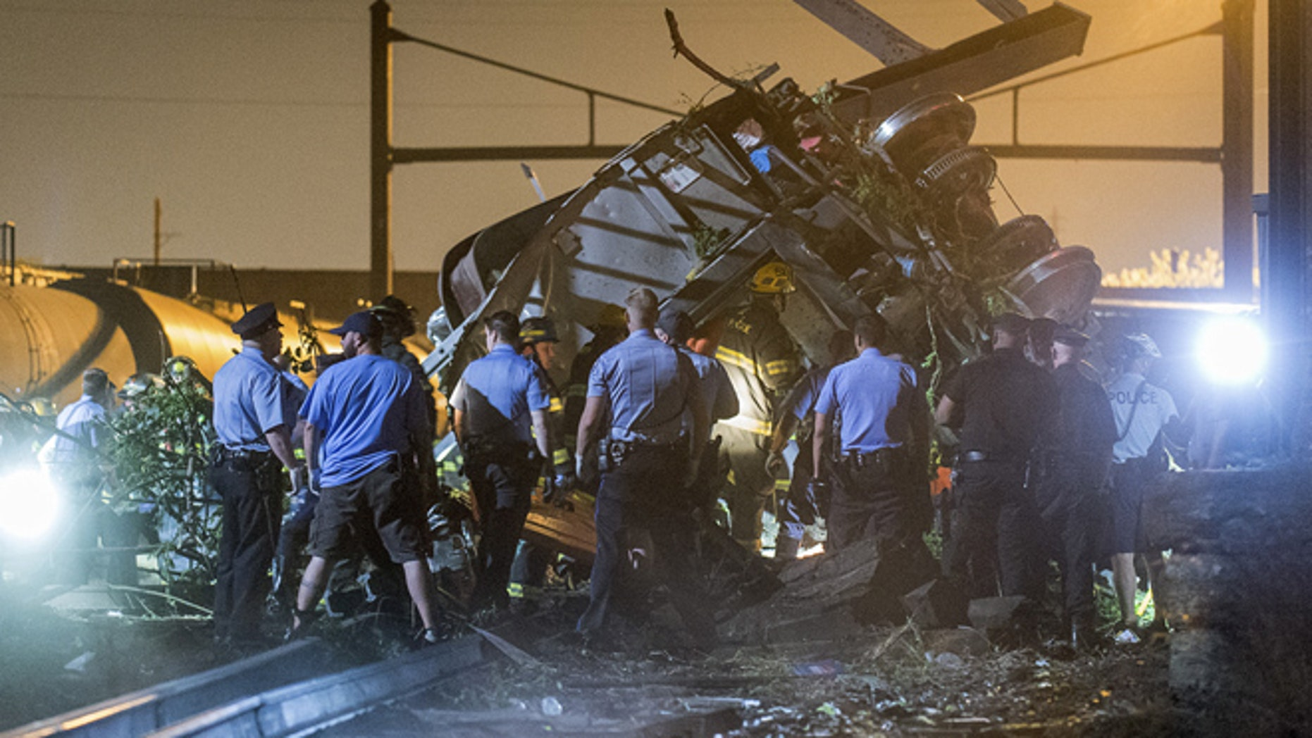 FILE 2015: Rescue workers search for victims in the wreckage of a derailed Amtrak train in Philadelphia