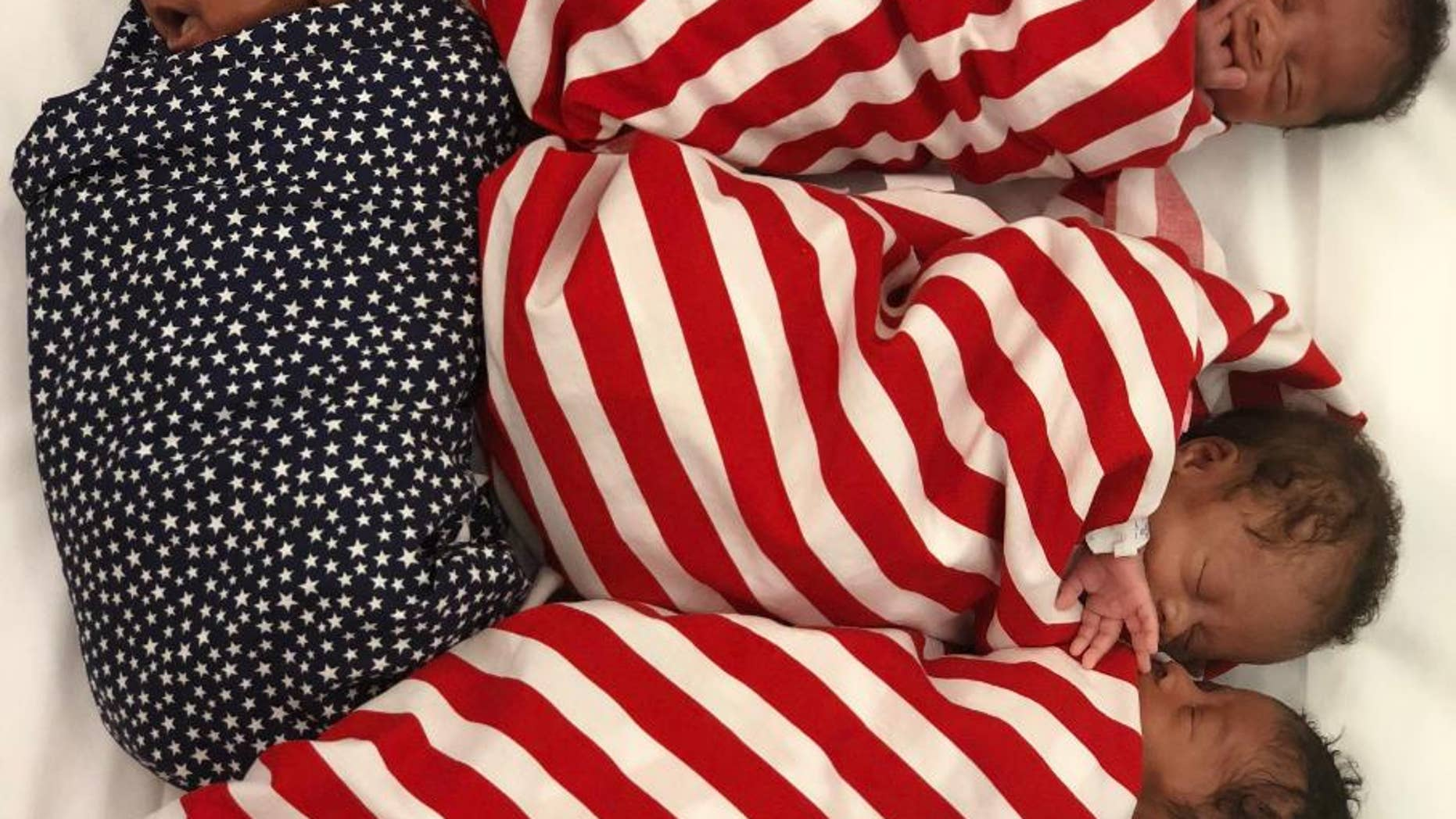 Quadruplets swaddled in stars and stripes going home on Fourth of July