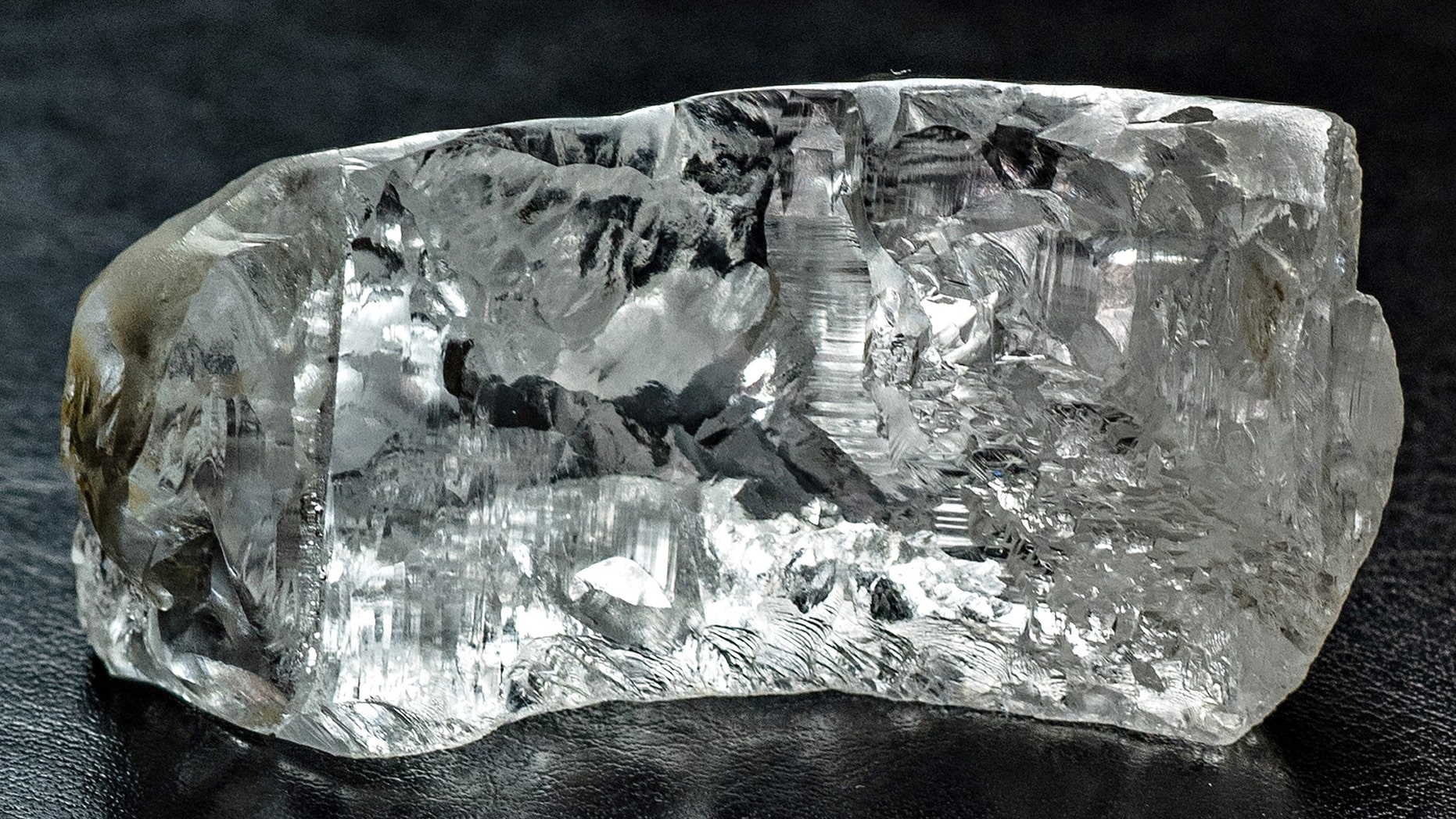 """The uncut 404-carat stone named the """"4 de Fevereiro"""" discovered in Angola in February 2016. The gem has been cut into a 163-carat D flawless diamond, (de Grisogono)."""