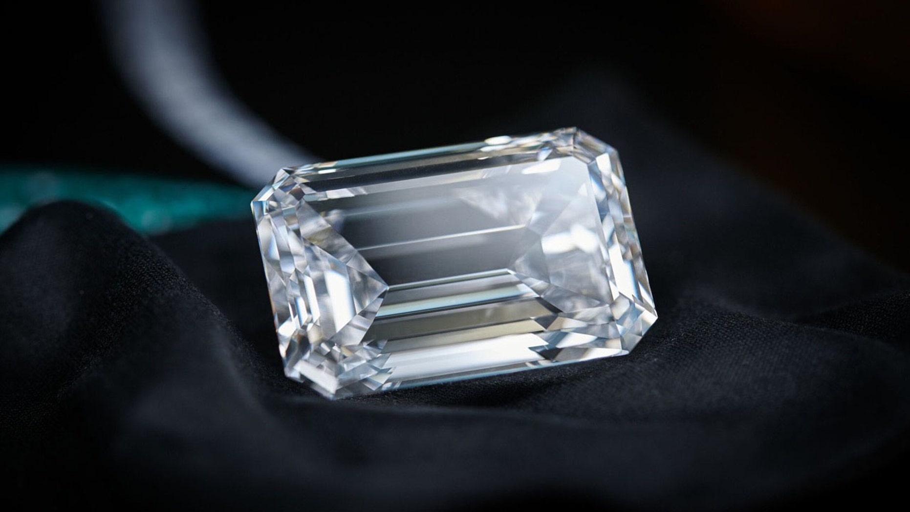 In this image released on Thursday, Sept. 28, 2017, a 163-carat flawless emerald stone, the largest of its kind ever to be put up for auction, has been unveiled in Hong Kong today. The finished piece, named The Art of de Grisogono will be presented in a series of public viewings around the world before it goes up for an auction at Christie's in Geneva on November 14.