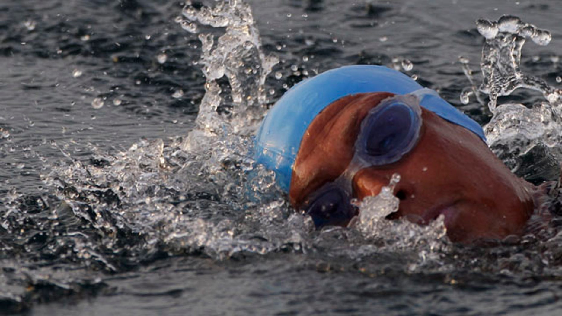 American endurance swimmer Diana Nyad , 61, swims in Cuban waters, offshore Havana, Cuba, Sunday, Aug. 7, 2011. Nyad jumped into Cuban waters Sunday evening and set off in a bid to become the first person to swim across the Florida Straits without the aid of a shark cage. (AP Photo/Franklin Reyes)