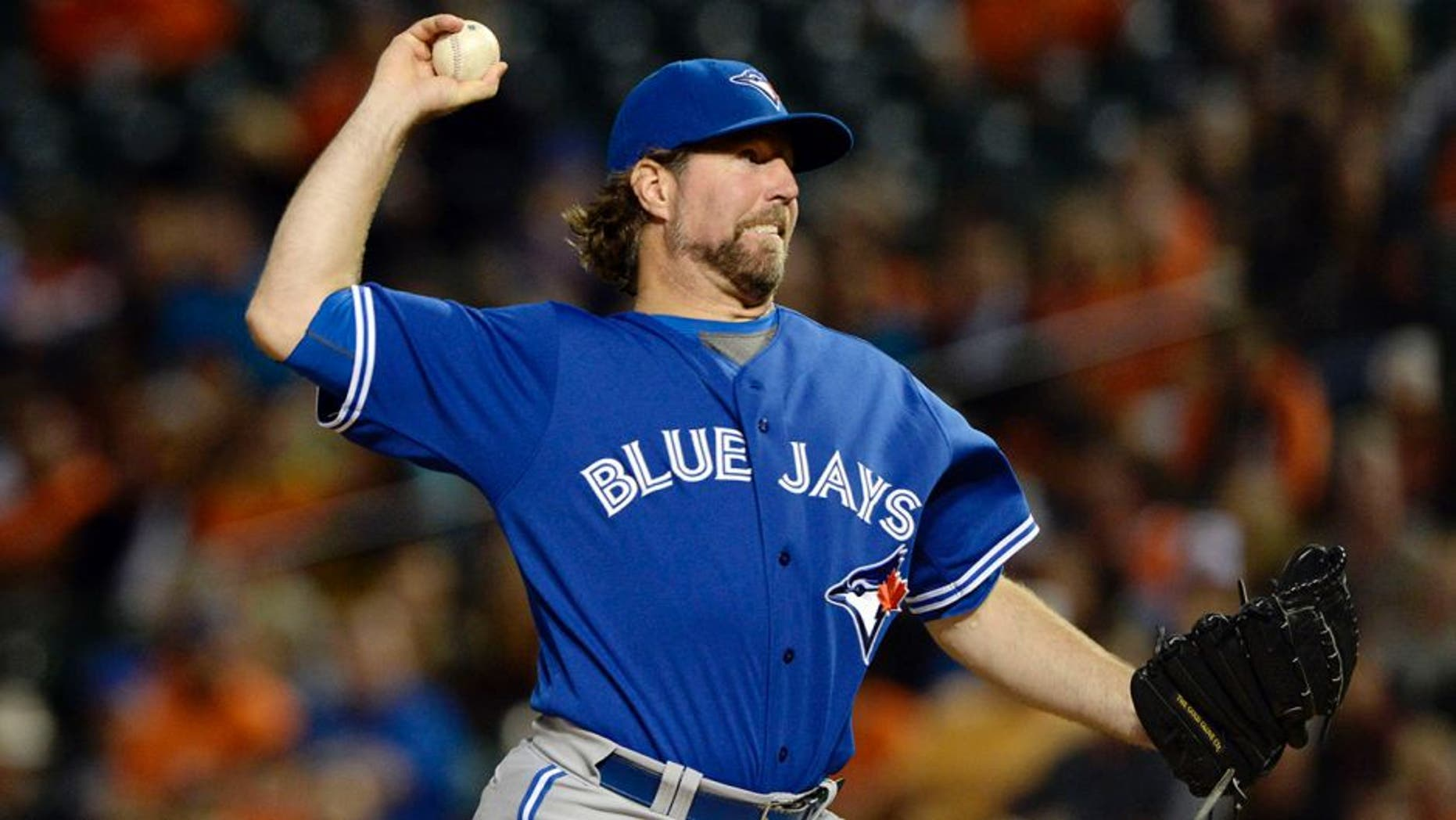 Sep 30, 2015; Baltimore, MD, USA; Toronto Blue Jays starting pitcher R.A. Dickey (43) pitches during the third inning against the Baltimore Orioles at Oriole Park at Camden Yards. Mandatory Credit: Tommy Gilligan-USA TODAY Sports