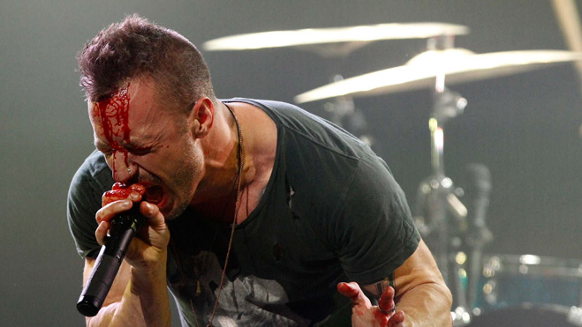 Greg Puciato of the Dillinger Escape Plan performing. The band were involved in a bus accident in Poland.