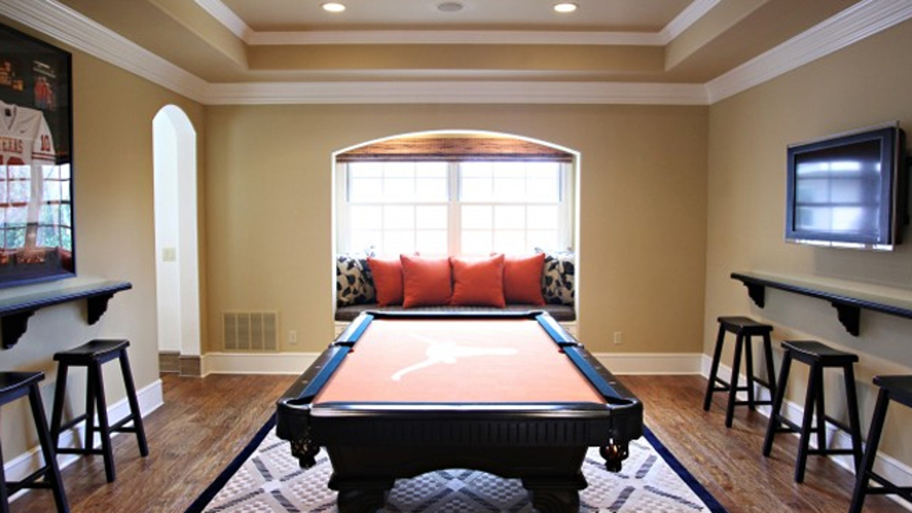 This dining room was re-envisioned as an entertainment room, with a dining table swapped out for a billiards table.