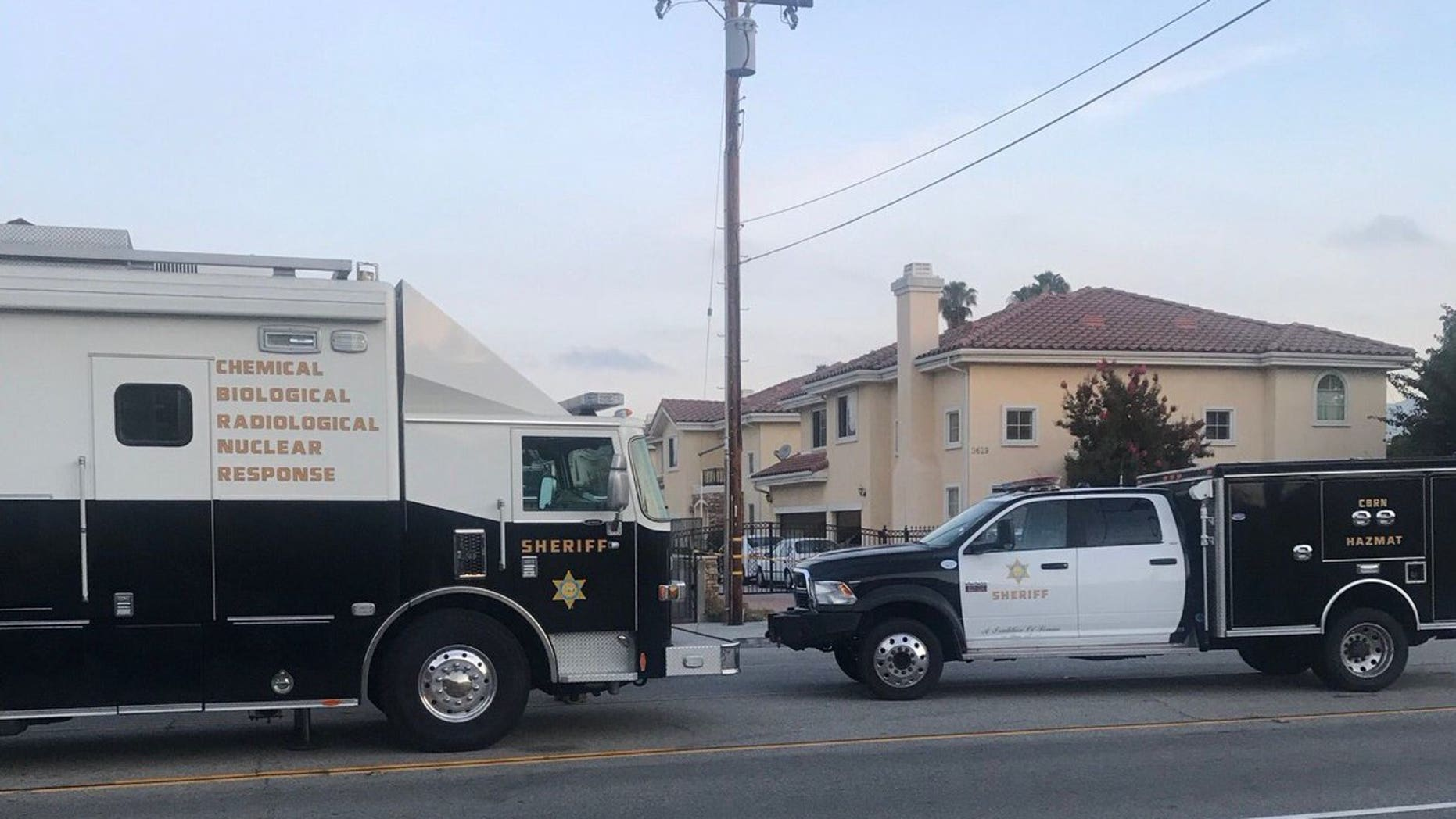 """El Monte police vehicles are seen near the site where an unknown suspect doused a woman with a """"caustic chemical."""""""
