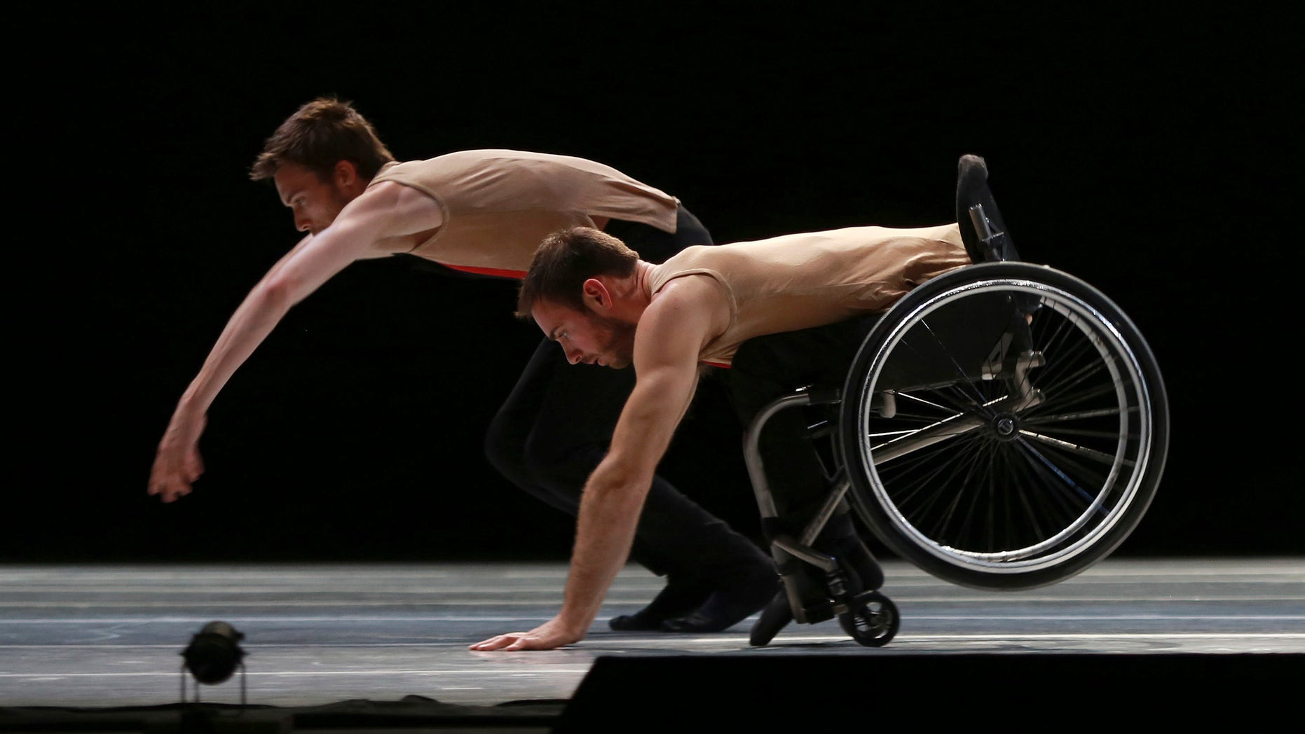 """Dancers from the United Kingdom's Candoco Dance Company perform a piece called """"Let's Talk About Dis"""" at the Guanajuato State Auditorium during the 43rd edition of the Cervantino International Festival in Guanajuato, Mexico, Sunday, Oct. 11, 2015. The Candoco Dance Company mixes disabled and non-disabled dancers in many of its choreographies. (AP Photo/Mario Armas)"""