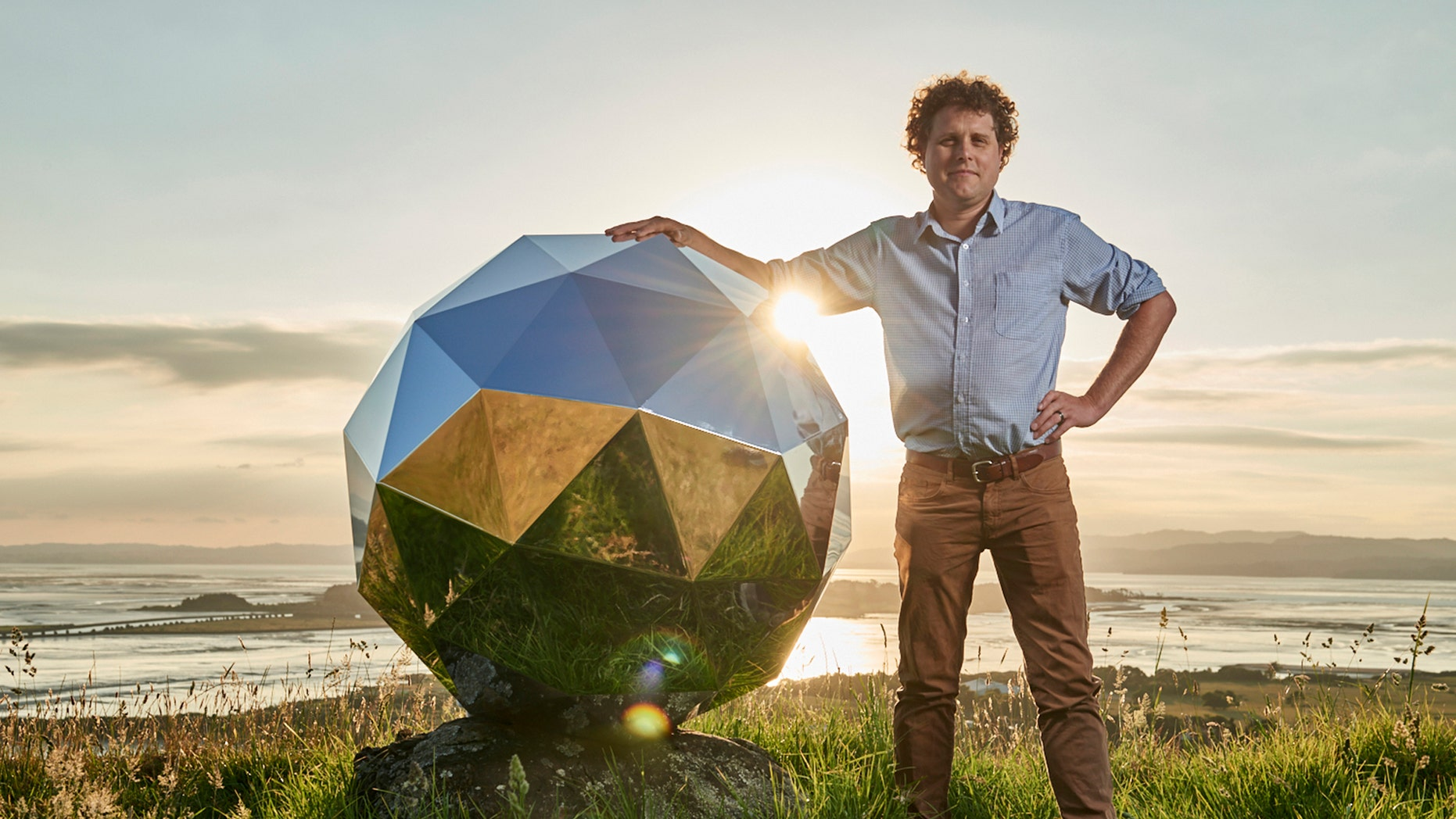 """File photo - In this Nov. 2017 photo provided by Rocket Lab, Rocket Lab founder and CEO Peter Beck is pictured with his """"Humanity Star"""" in Auckland, New Zealand. (Rocket Lab via AP)"""