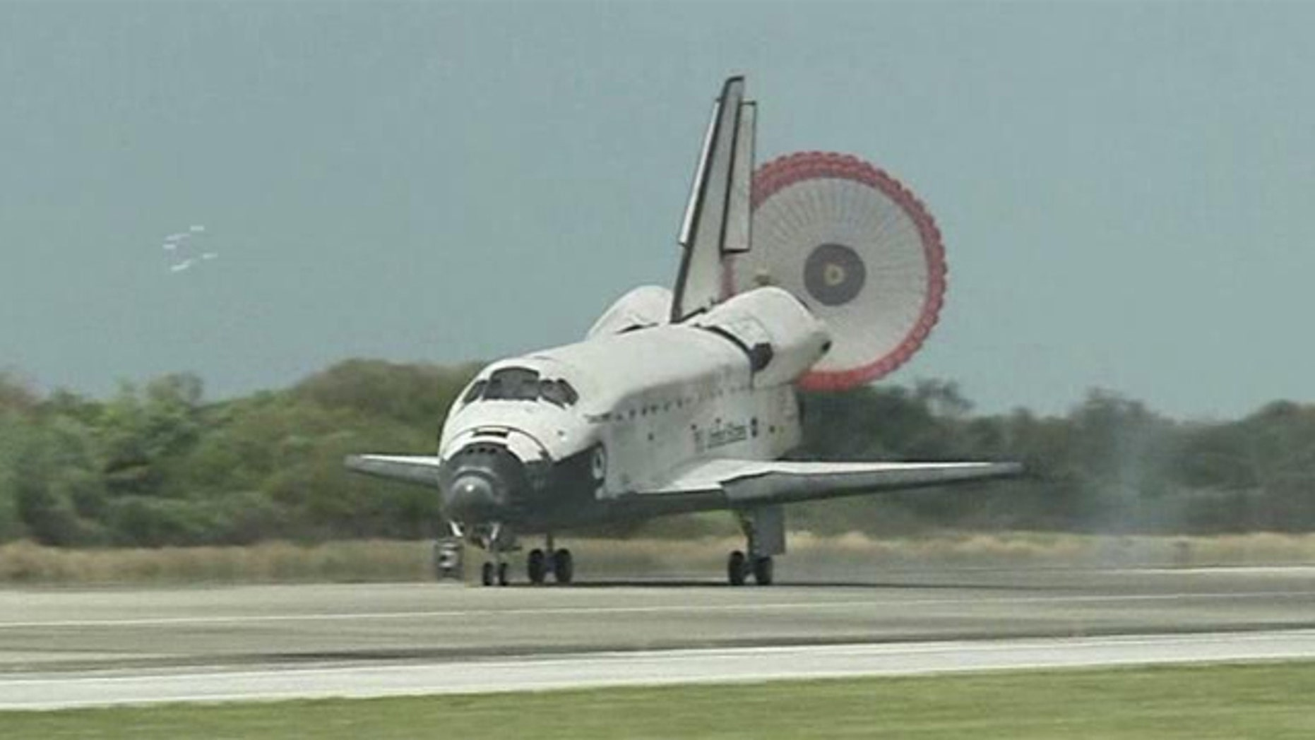 Space shuttle discovery rolls to its final landing at Kennedy Space Center in Florida.