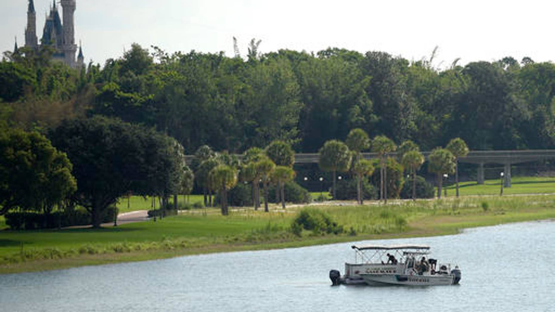 June 15: Orange County Sheriff's officers are seen searching for the boy in the Seven Seas Lagoon between Walt Disney World's Magic Kingdom theme park, left, and the Grand Floridian Resort & Spa.