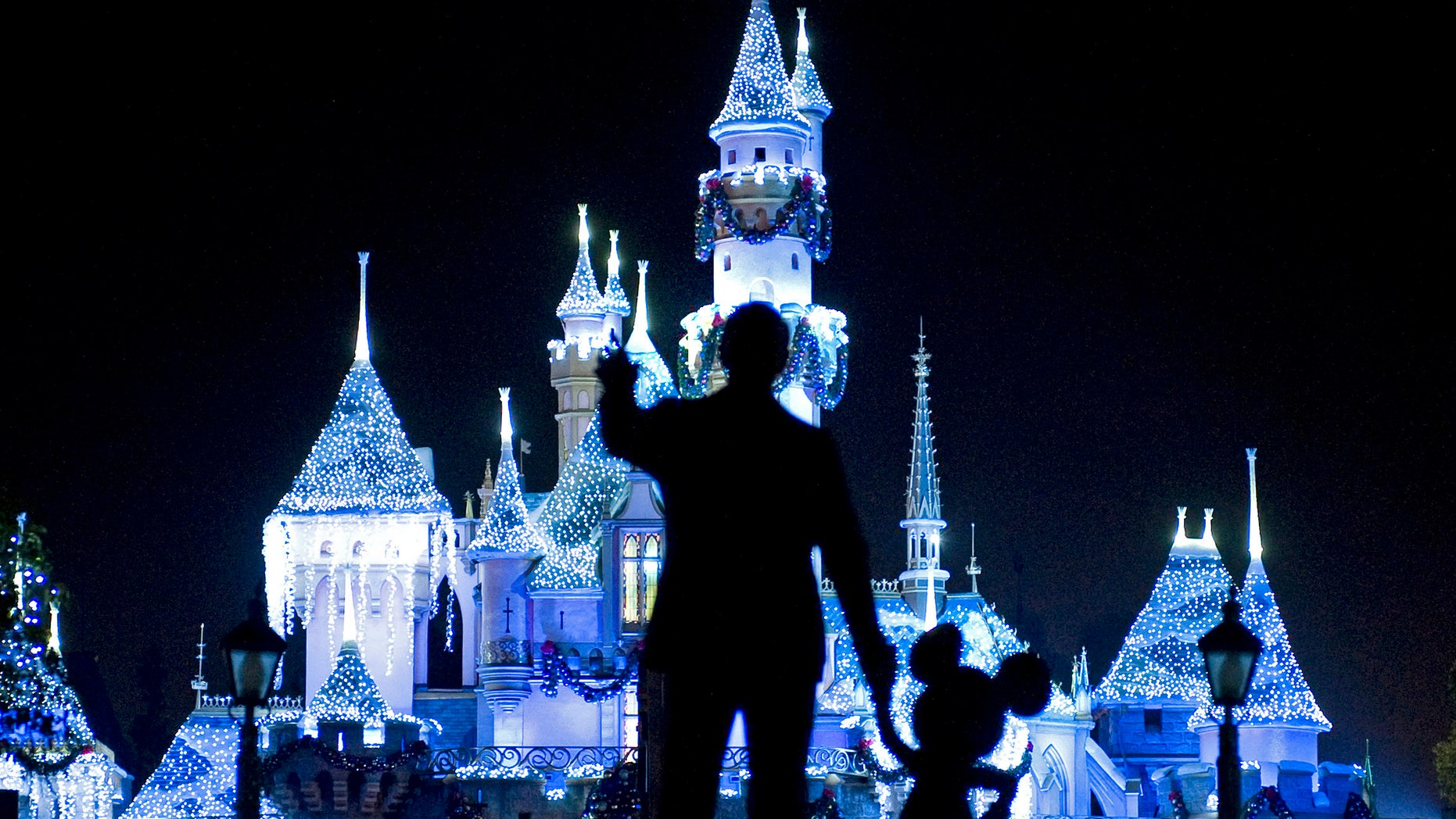 "Nov. 20, 209: Sleeping Beauty's Castle in winter dress with the iconic ""Partners"" statue featuring images of Walt Disney and Mickey Mouse in the foreground, at Disneyland in Anaheim, Calif."
