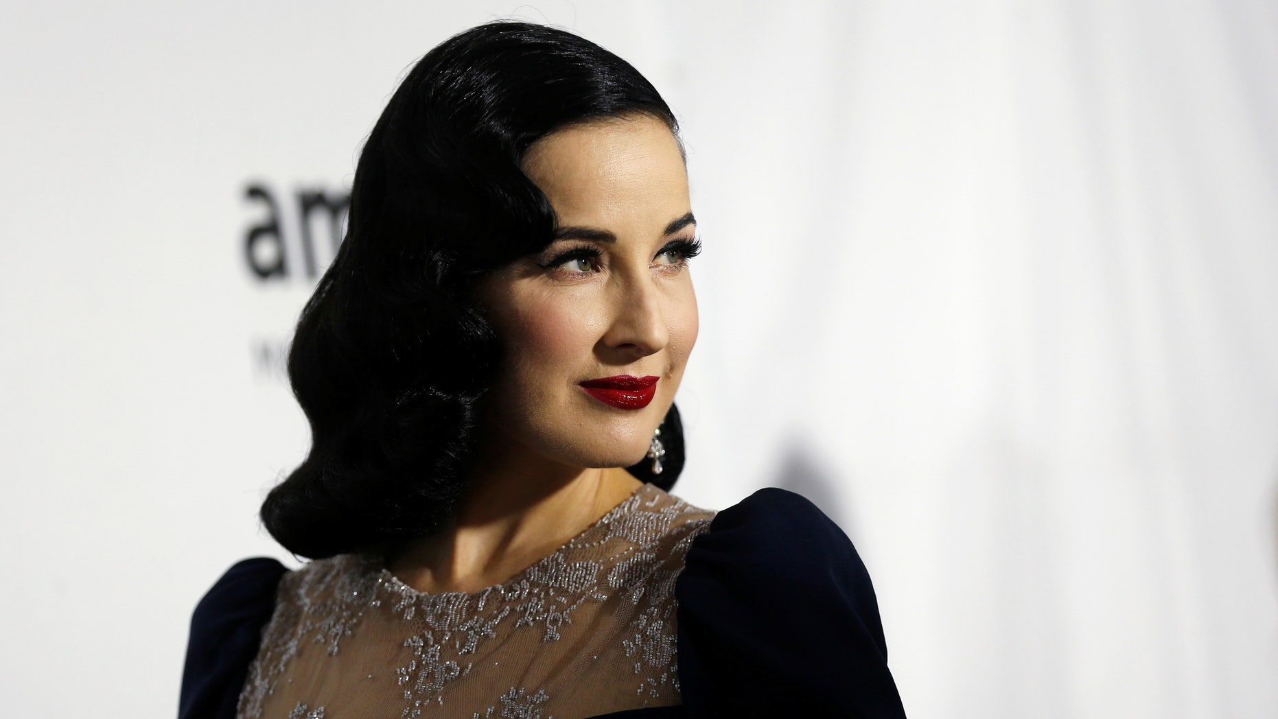 Performer Dita Von Teese poses at the 2016 amfAR Inspiration Gala in Los Angeles, California U.S., October 27, 2016. REUTERS/Mario Anzuoni - RTX2QSHY