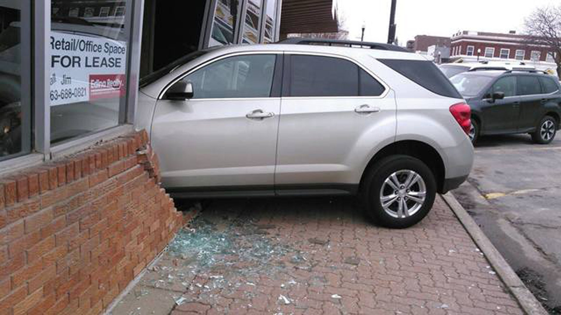 A 17-year-old reportedly put her car in drive instead of reverse while taking her driving exam.