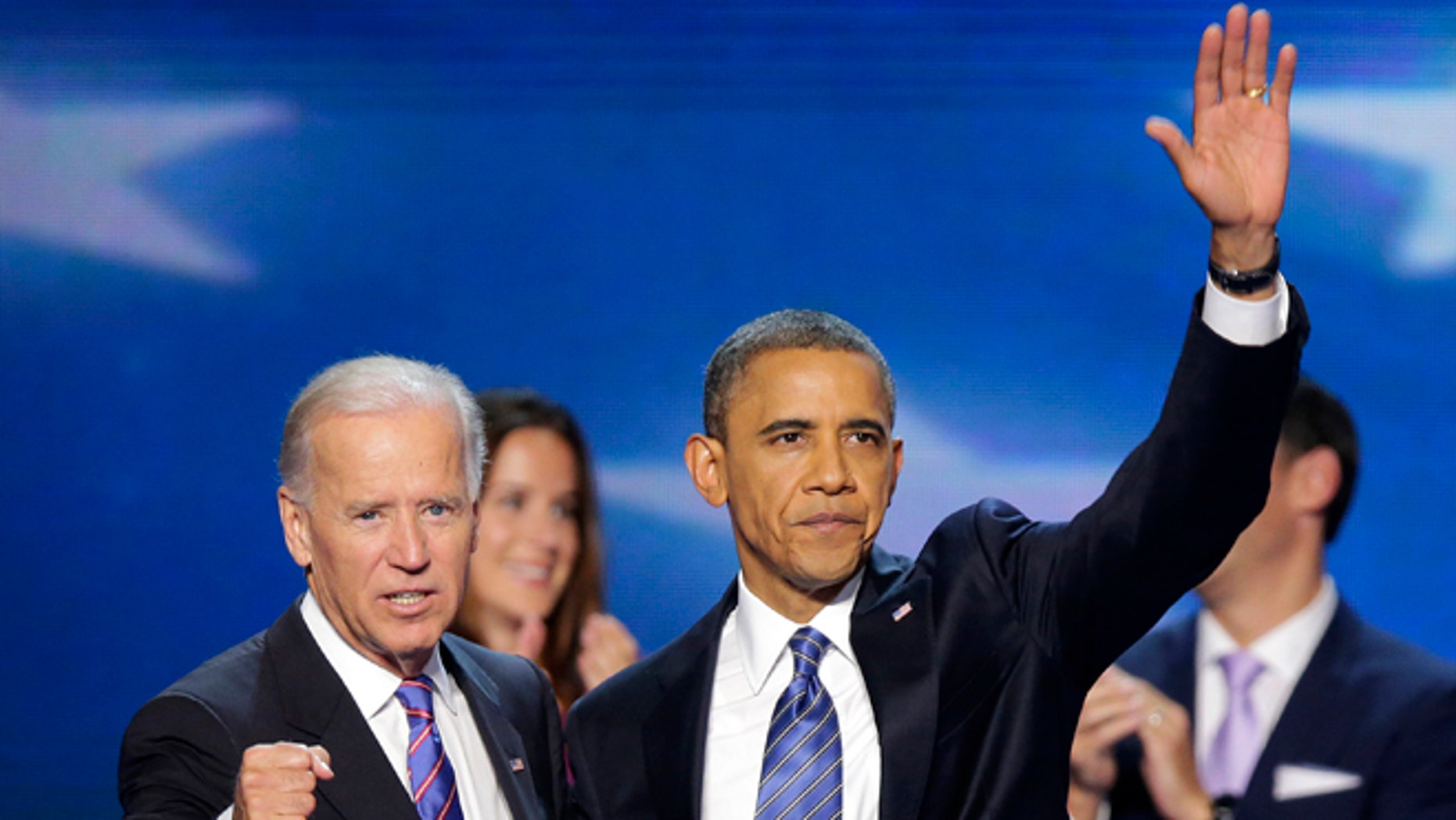 Sept. 6, 2012: Vice President Joe Biden and President Barack Obama wave to the delegates after President Obama's speech to the Democratic National Convention in Charlotte, N.C.